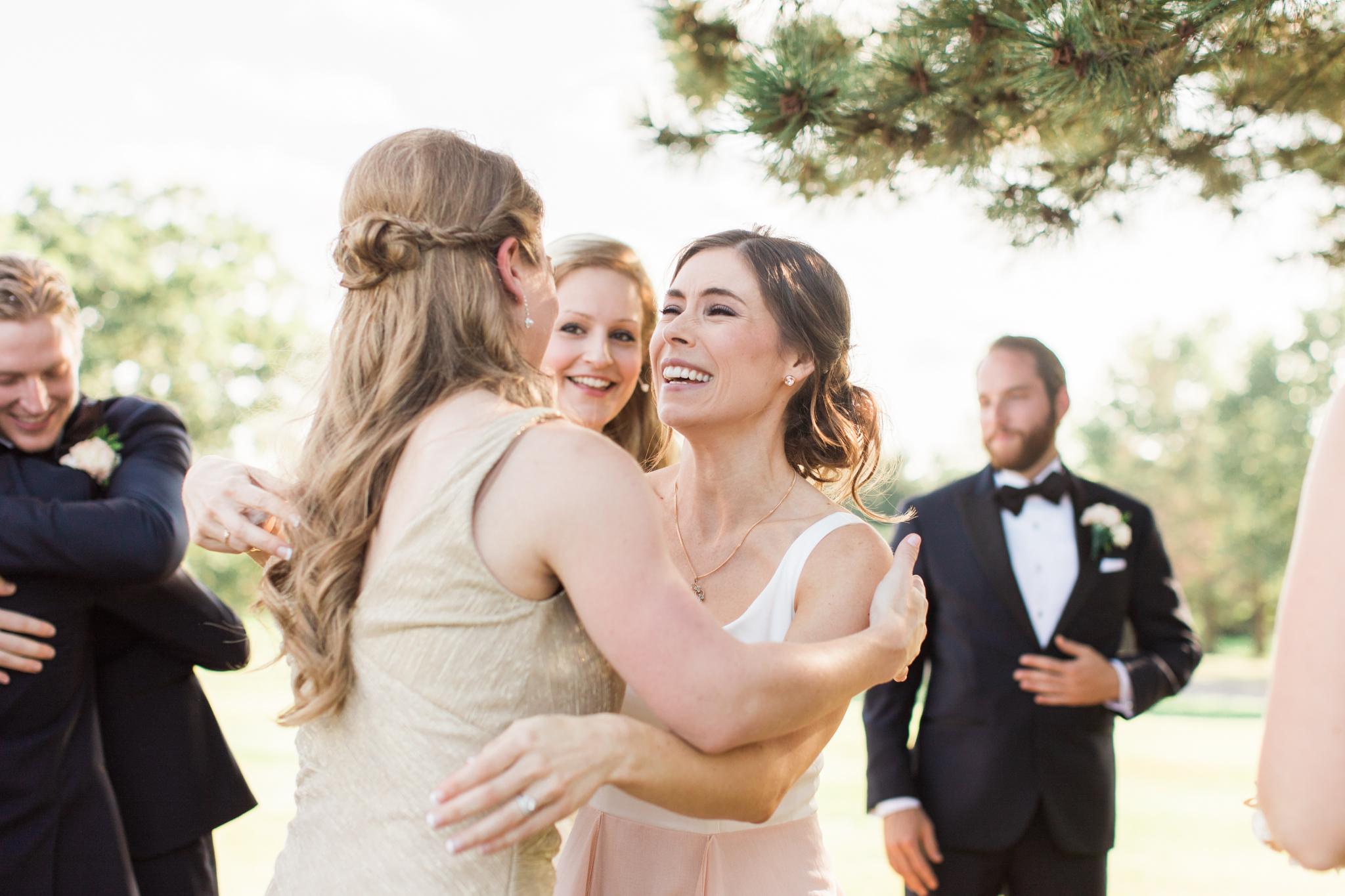 bride hugging at little turtle club outdoor ceremony in columbus ohio