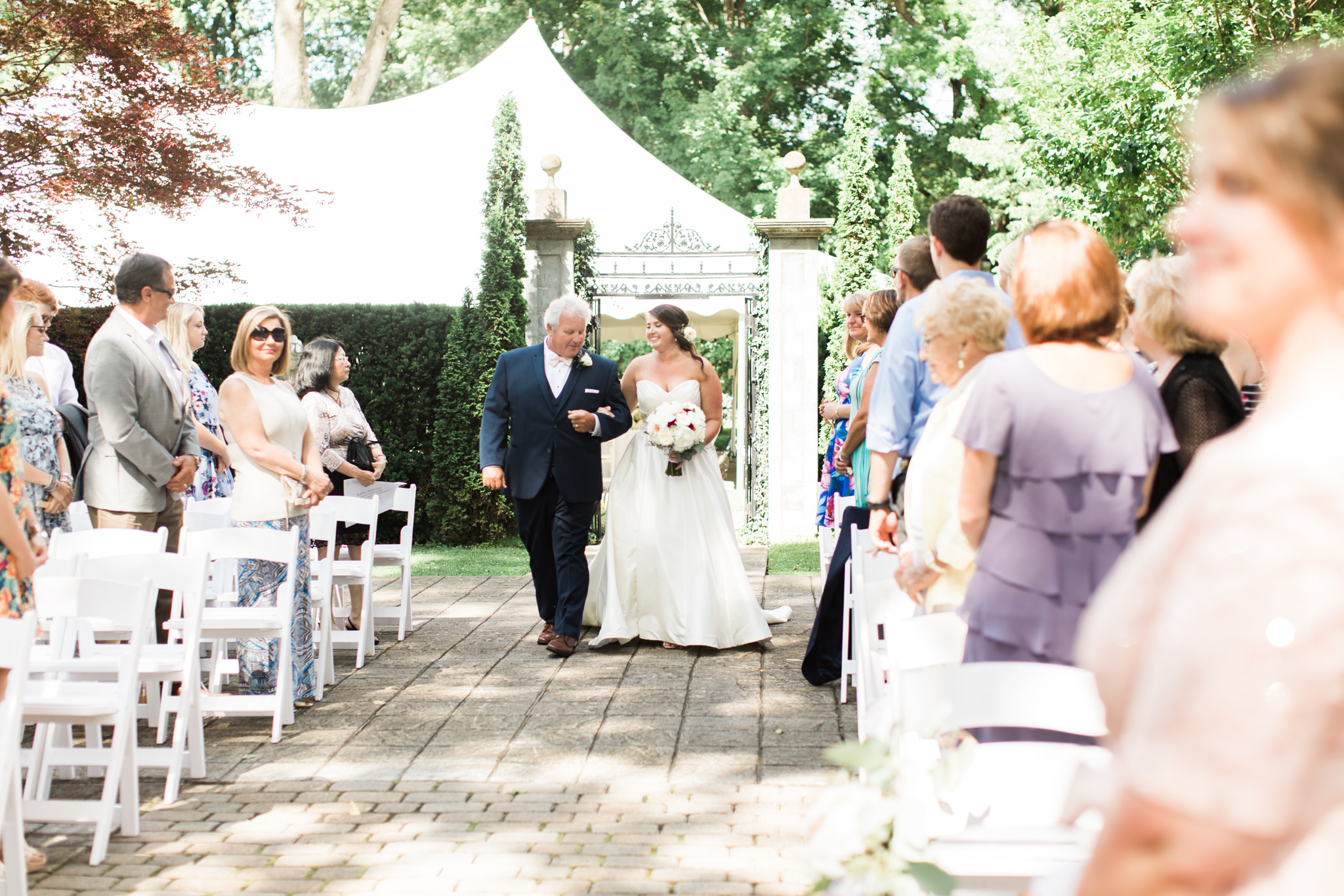 Michele focusing on capturing the emotion of the bride and her dad as they walk down the aisle