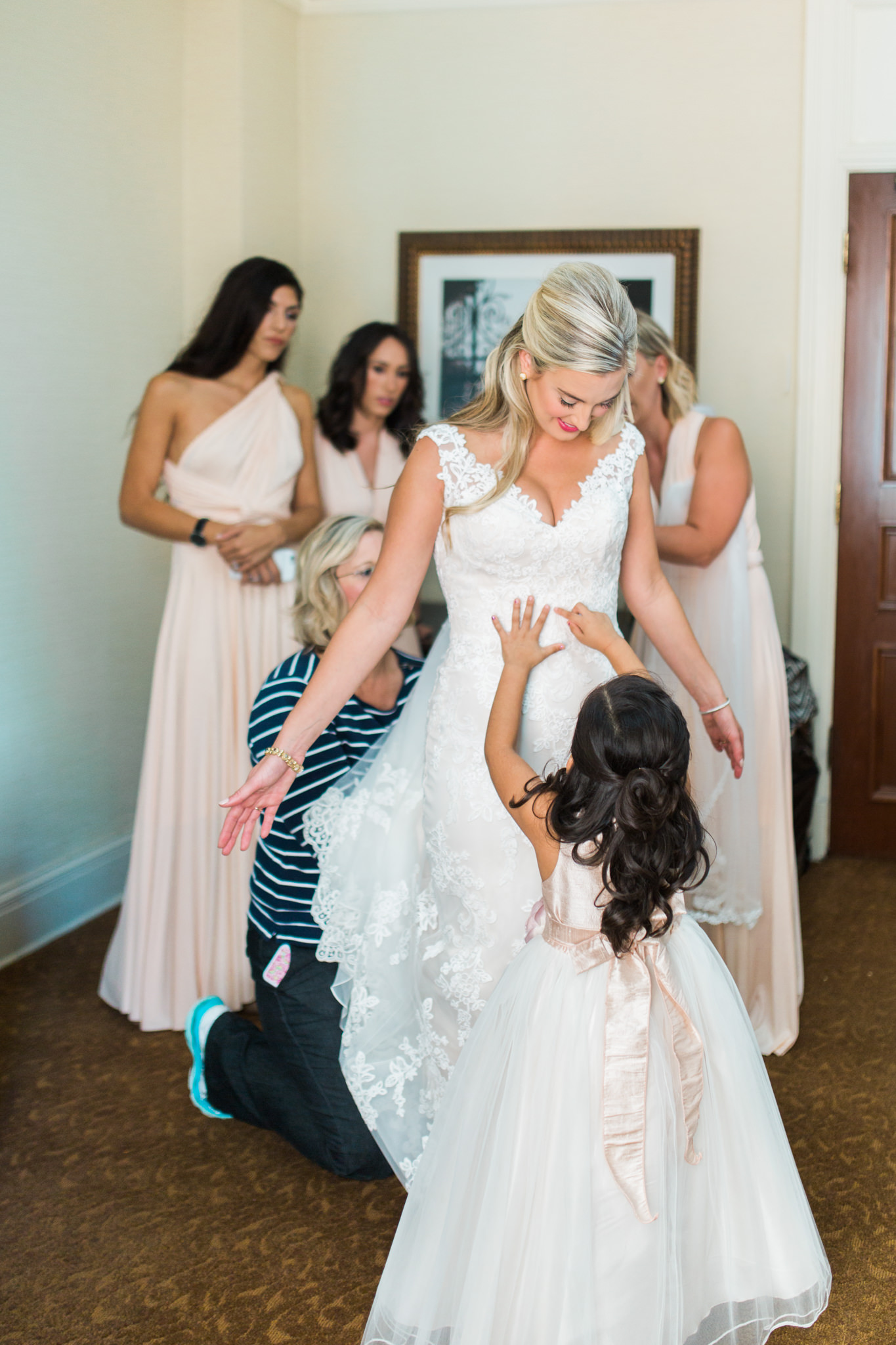 Bride and little sister playing while getting ready