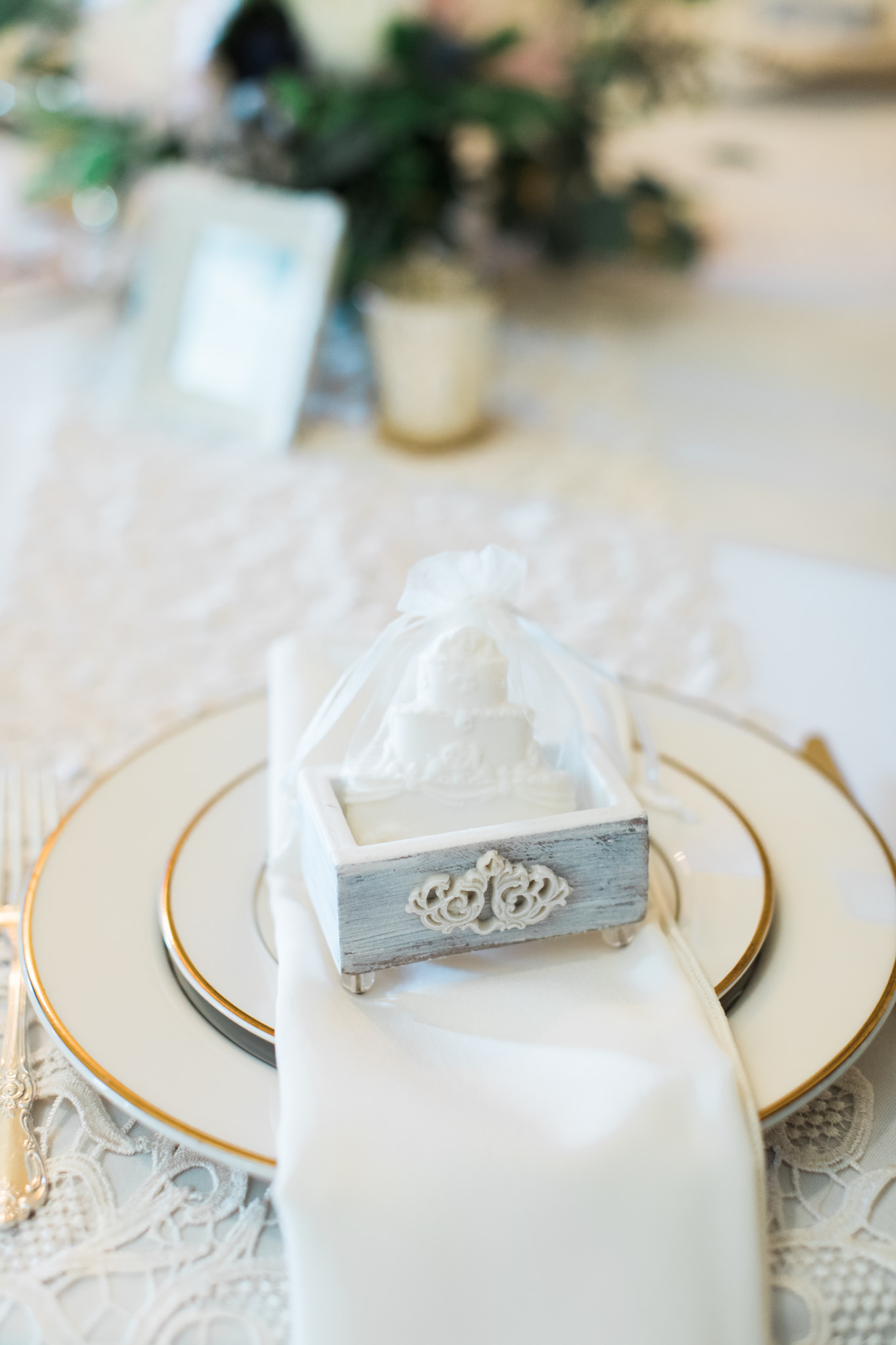 White wooden deco box with white chocolate cake inside wedding favor