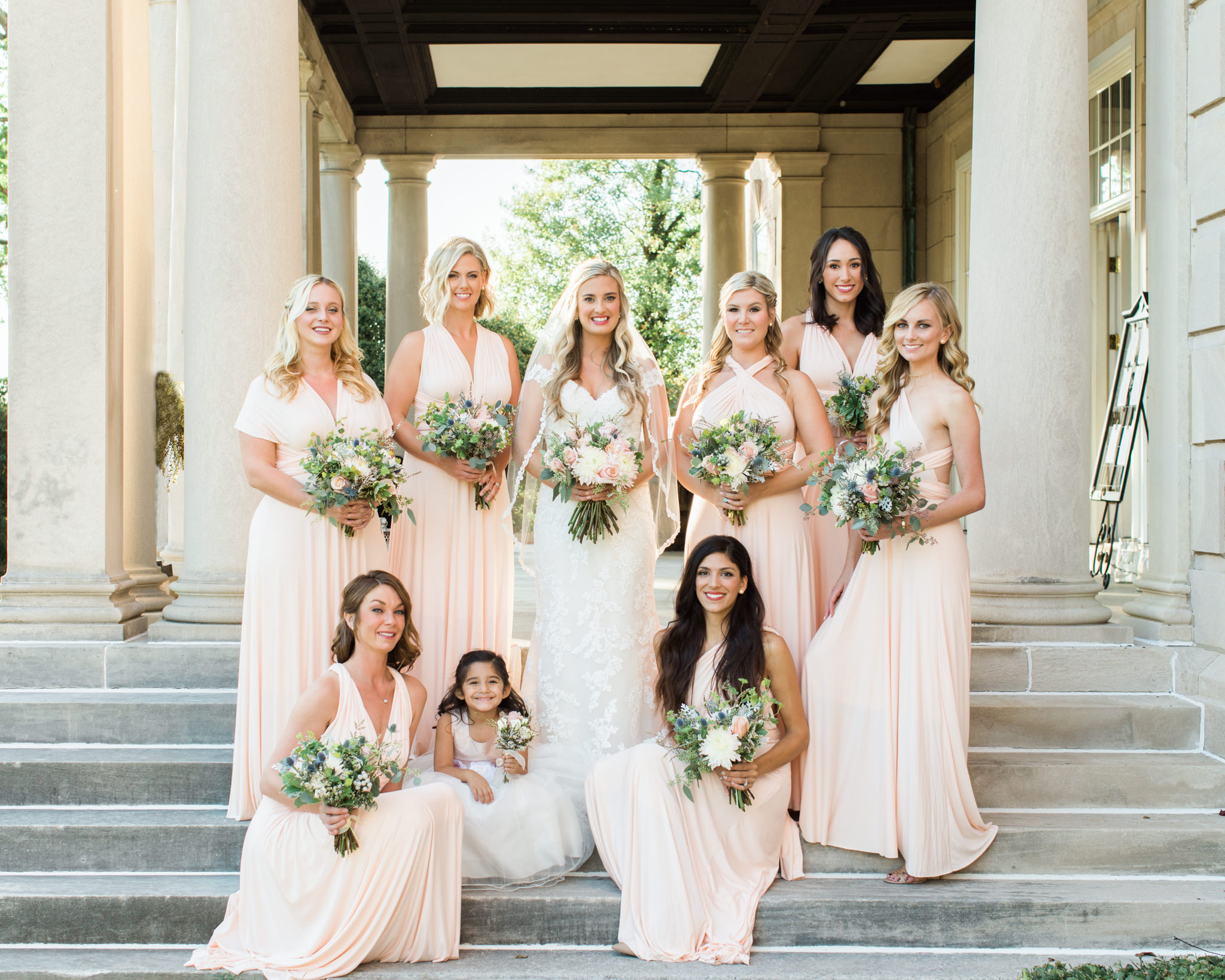 Bridesmaids on steps at Garden Court wedding venue louisville ky