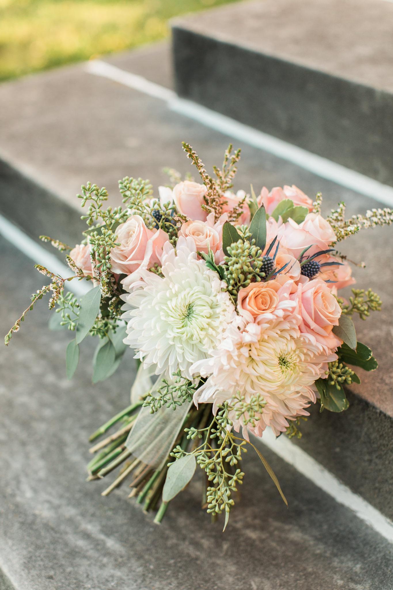 Bouquet outside on steps at Gardencourt Louisville Wedding Venue