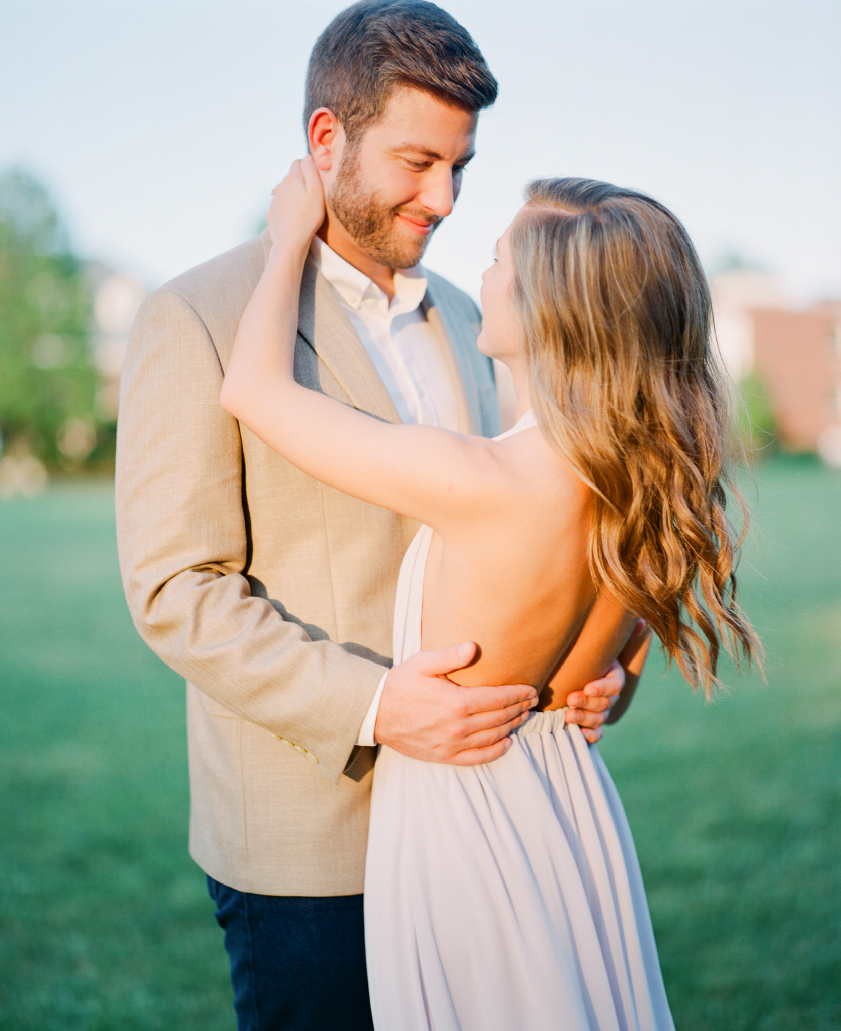 Film photograph from a Pentax 67 with 105mm 2.4 taken of couple romanctically embracing one another at Southern Baptist Theological Seminary during their engagement session.