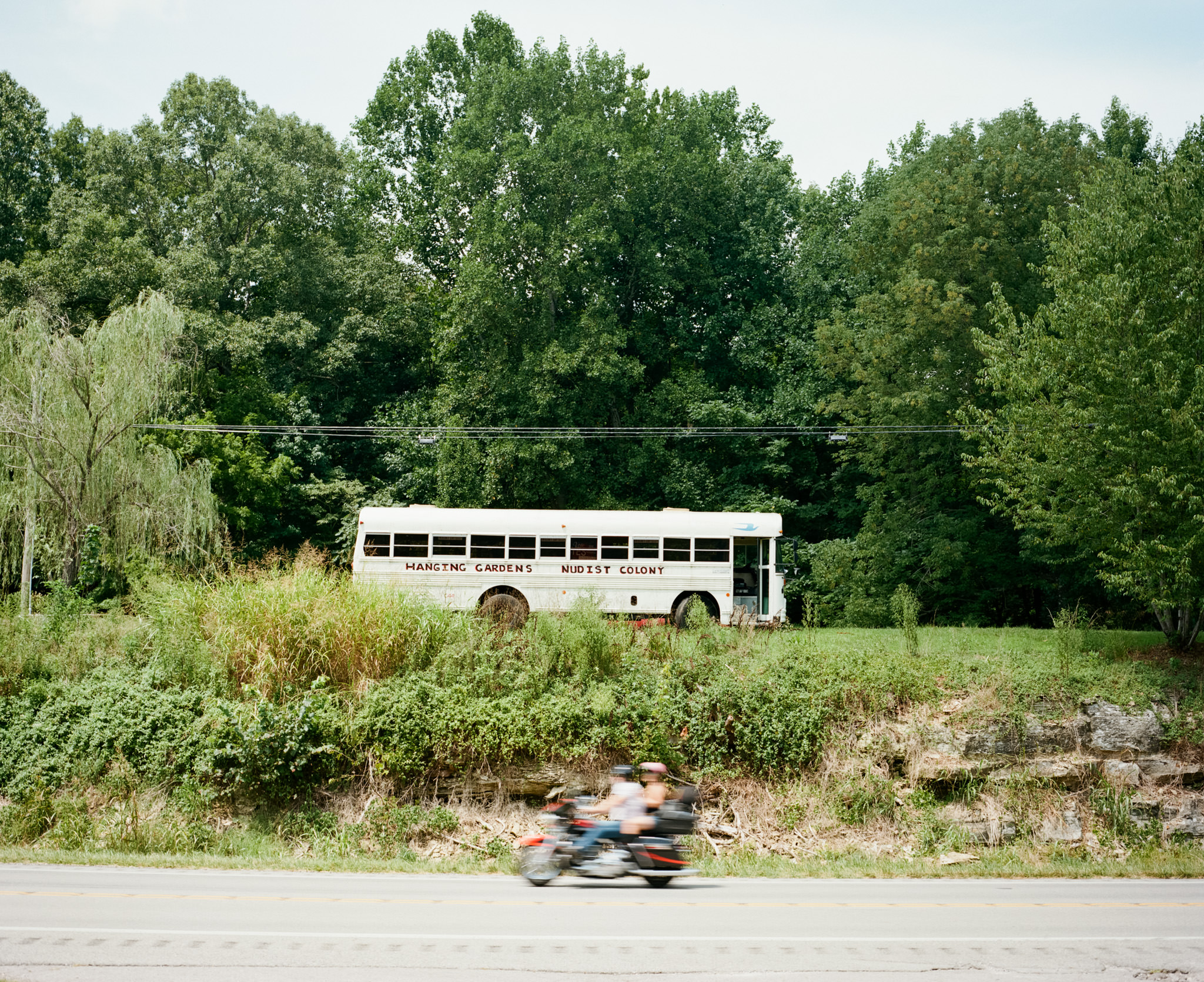 Image of white bus with Hanging Gardens Nudist Colony written on side, taken with the Mamiya 7 and 80mm f/4 lens