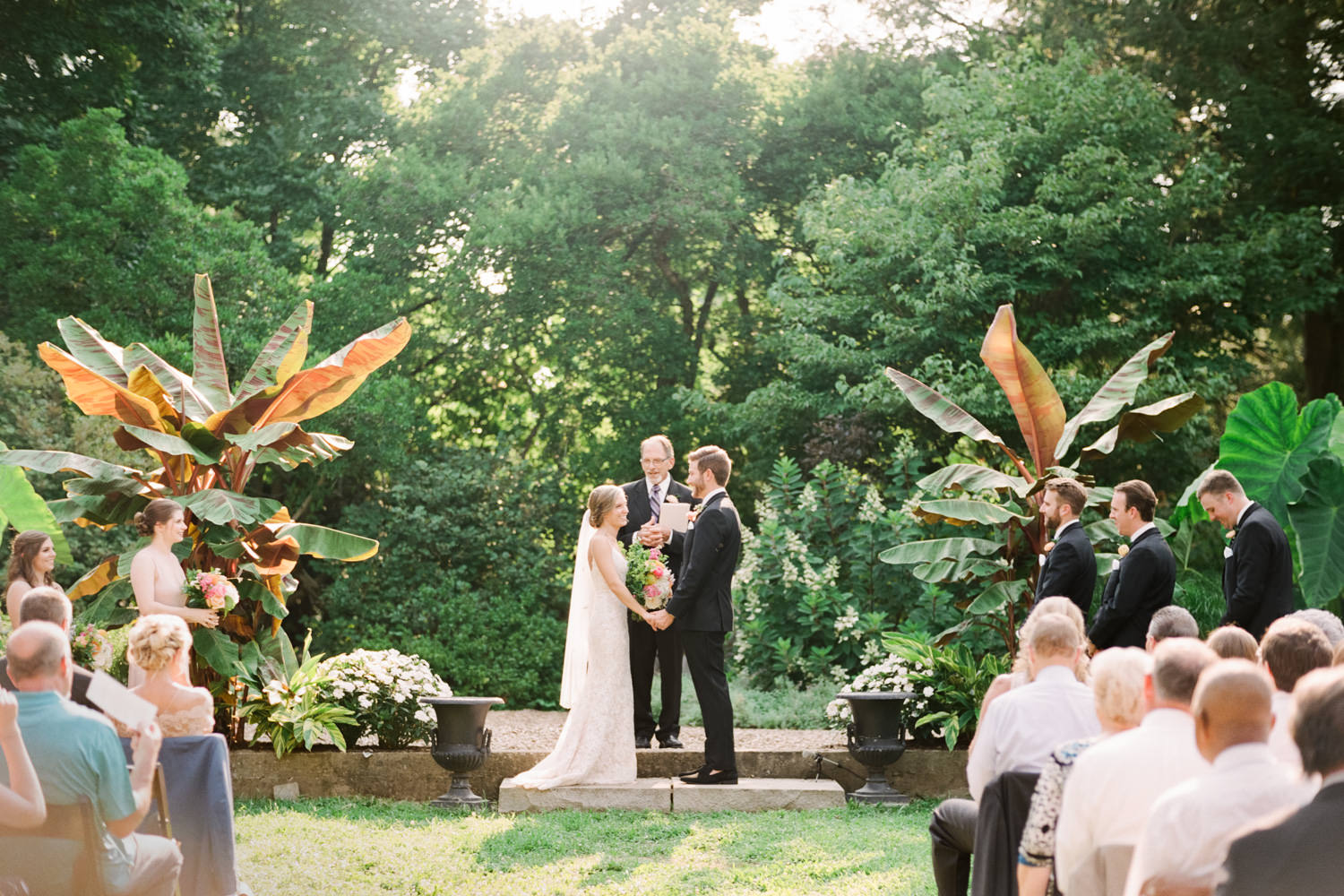 Yew Dell Wedding Photo of Bride and Groom in lush garden area outdoors at the Botanical Garden in Louisville, Ky