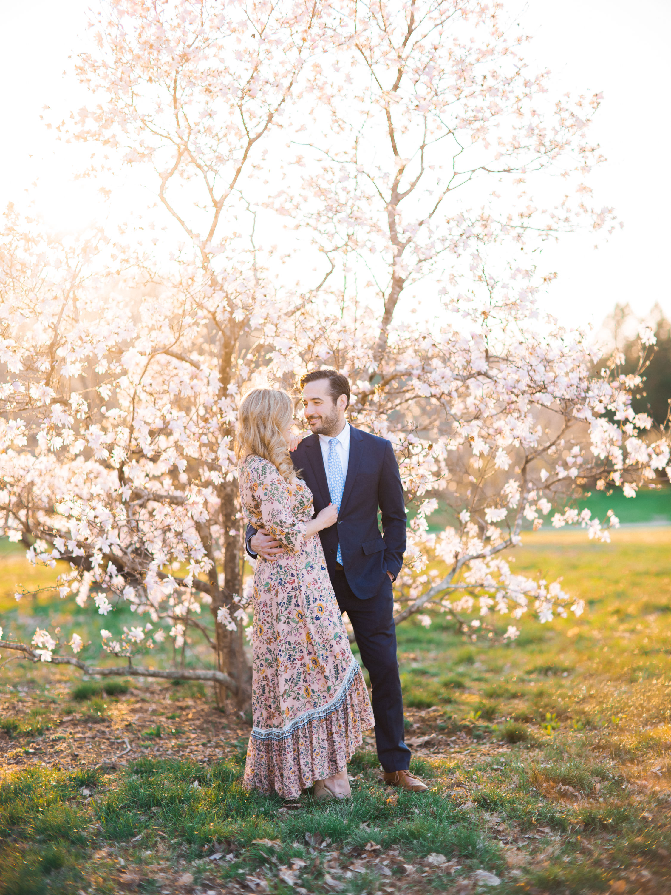 How much should I spend on a wedding photographer post photo of couple during engagement session