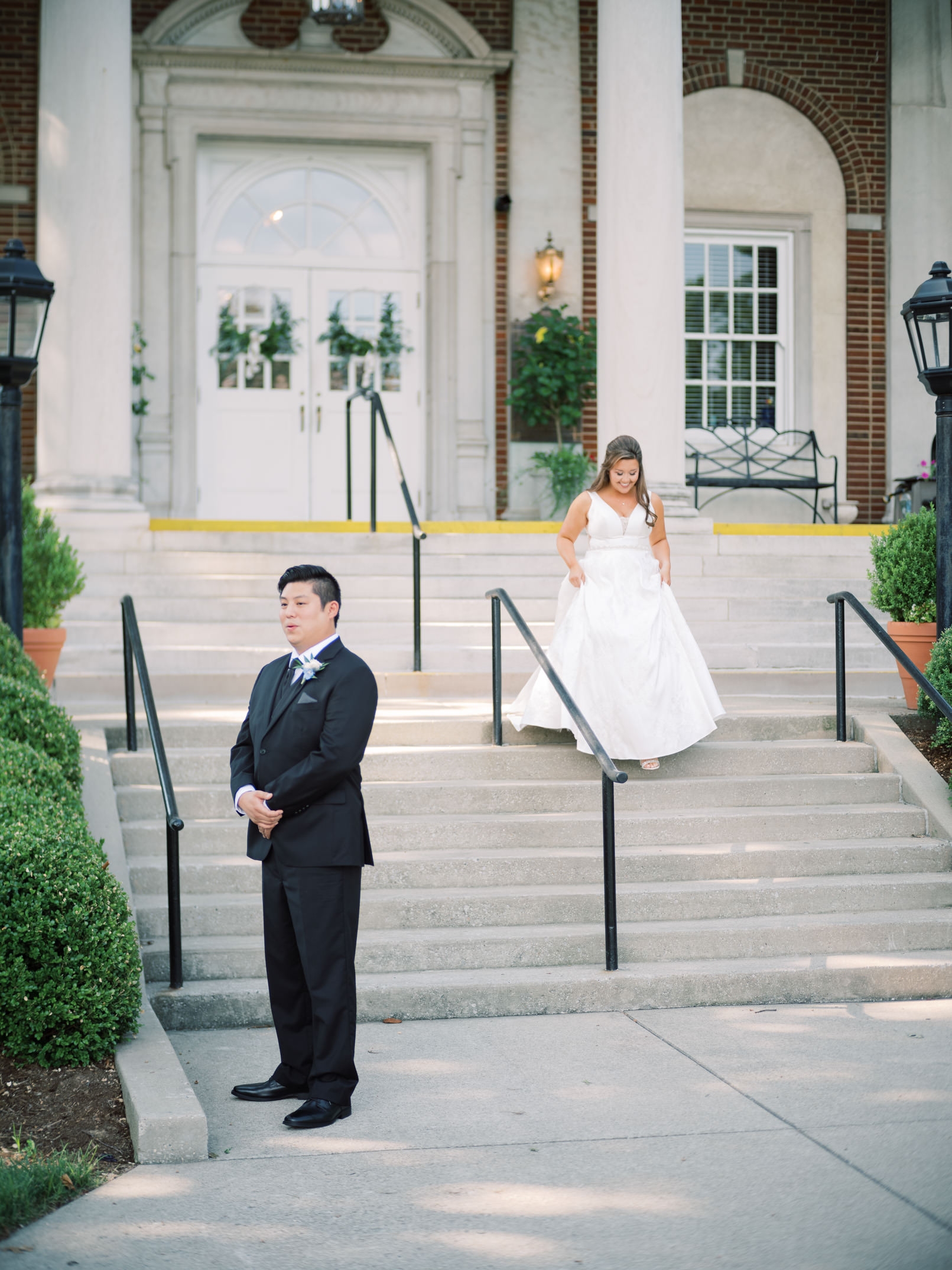 Image at a historic wedding venue in Louisville, Kentucky of bride approaching the anticipating groom during first look