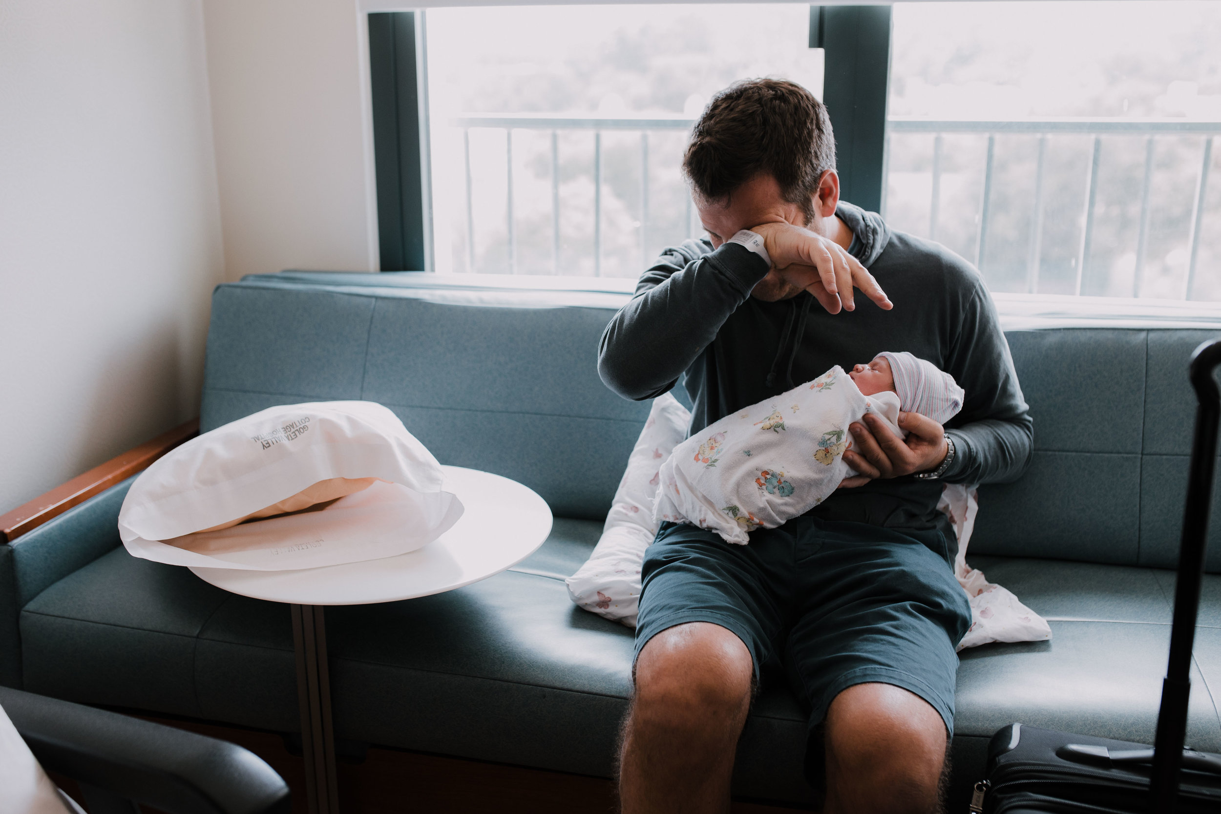 A dad cries when holding his daughter for the first time-  Looks Like Film Feature