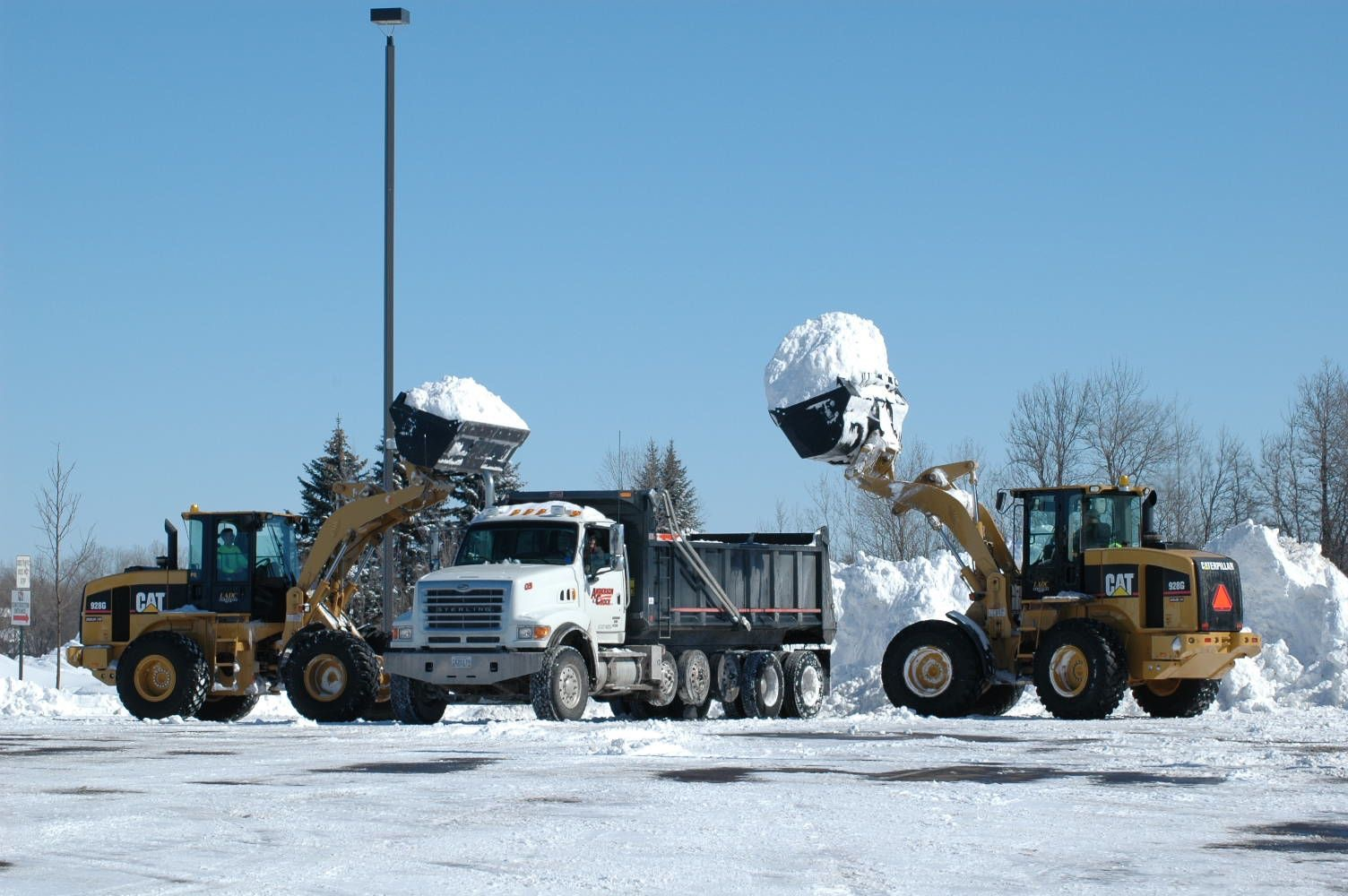 Snow Hauling - Don't let snow depict sales coming in. Take charge and call us today to remove it from your site.