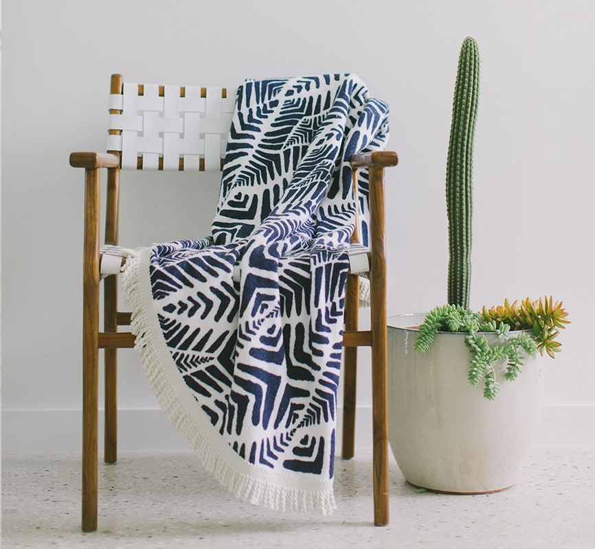 The Paridis - oui oui it is French for Paradise - dreamy navy blue zebra-inspired print with silky cream tassel.