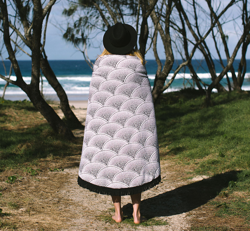The Amaroo - a black dot fish scale pattern with a name that is Indigenous for 'a beautiful place'. This sophisticated black & white design comes complete with a soft black tassel.