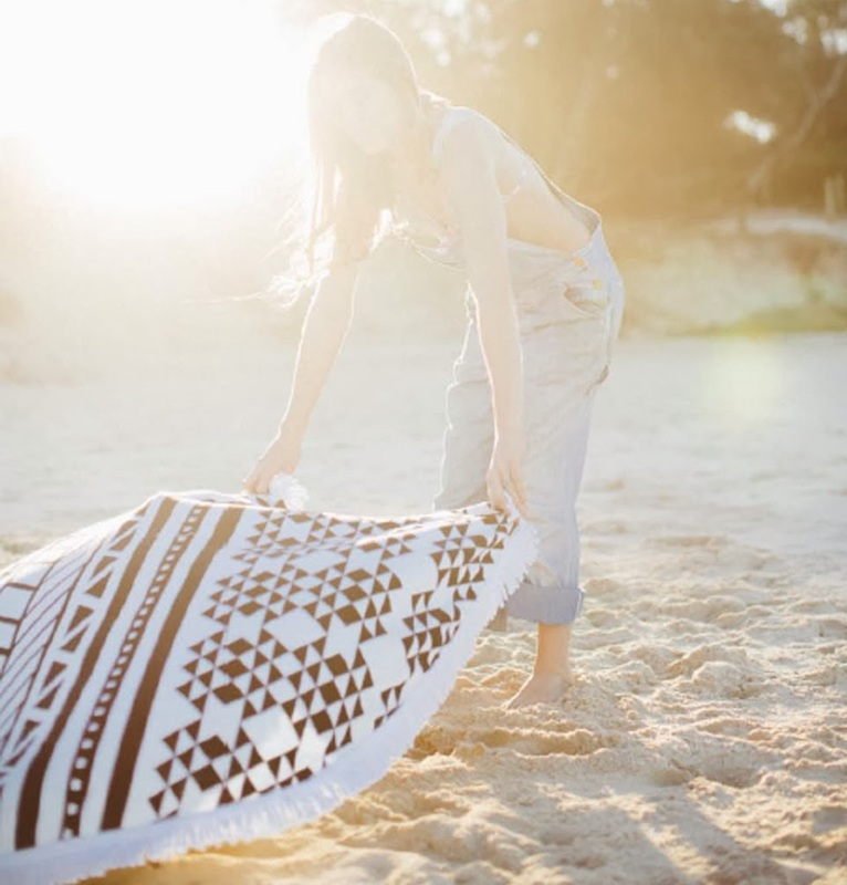 The original roundie - Aztec inspired black and white print with a white tassel.