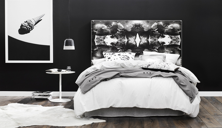 SMOKE & MIRRORS - The combination of sharp geometric patterns and blurred lines sees Smoke & Mirrors create a bold statement in the bedroom. This self-assured piece is best complemented with layers of black & white. Accentuate the silver metallic piping by pairing in metallic accessories.