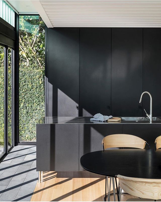 A black kitchen with all the natural light 🖤  Light Box House by @crossonarchitects  As featured on @thelocalproject  Photography @simon.c.wilson