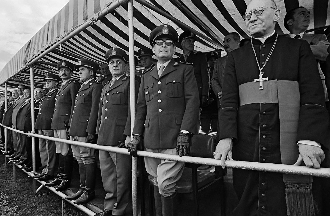 President Jorge Rafael Videla, army officers and bishop. Argentina, 1976