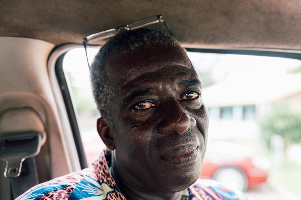 'Kojo' - I am a husband, a father of 2 daughters and I work as a driver for the Church. I have lived in Ghana my whole life. I like Ghana because it is a peaceful place.I trained as office machine technician but over time people stopped using these machines so I needed to find a new job. I was in church one week and they said that the MCG was looking for drivers so I said yes, I will do that. I enjoy working for the Methodist Church, it is my service to God. I have been driving for the church for 25 years. I love driving more than the job I originally trained for! I enjoy meeting lots of people from many countries. The difficult thing is other drivers! A lot of them are not educated so they don't understand the road signs and systems. Most accidents are caused by human error.I have also started my own small farm. I grow kasava and use this money to pay my children's school fees. My first daughter wants to be a nurse and the second daughter wants to be a pharmacist. I don't enjoy the farming very much but I will retire at 60 so the farming is like my retirement.Driver for Methodist Church Ghana
