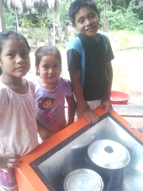 The children with the new solar oven