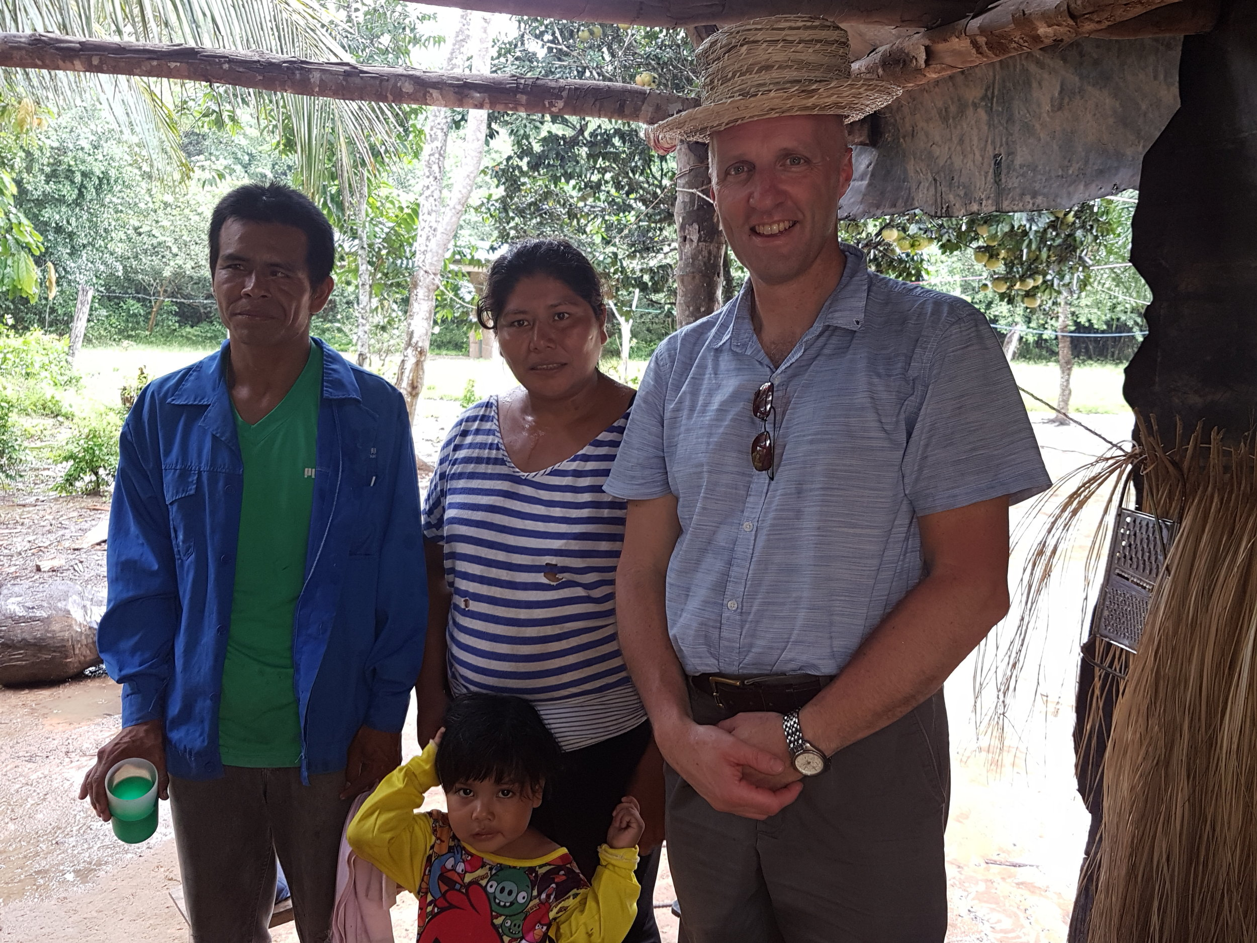 Laurence pictured with Mariella and her family,wearing the hat she made for him.