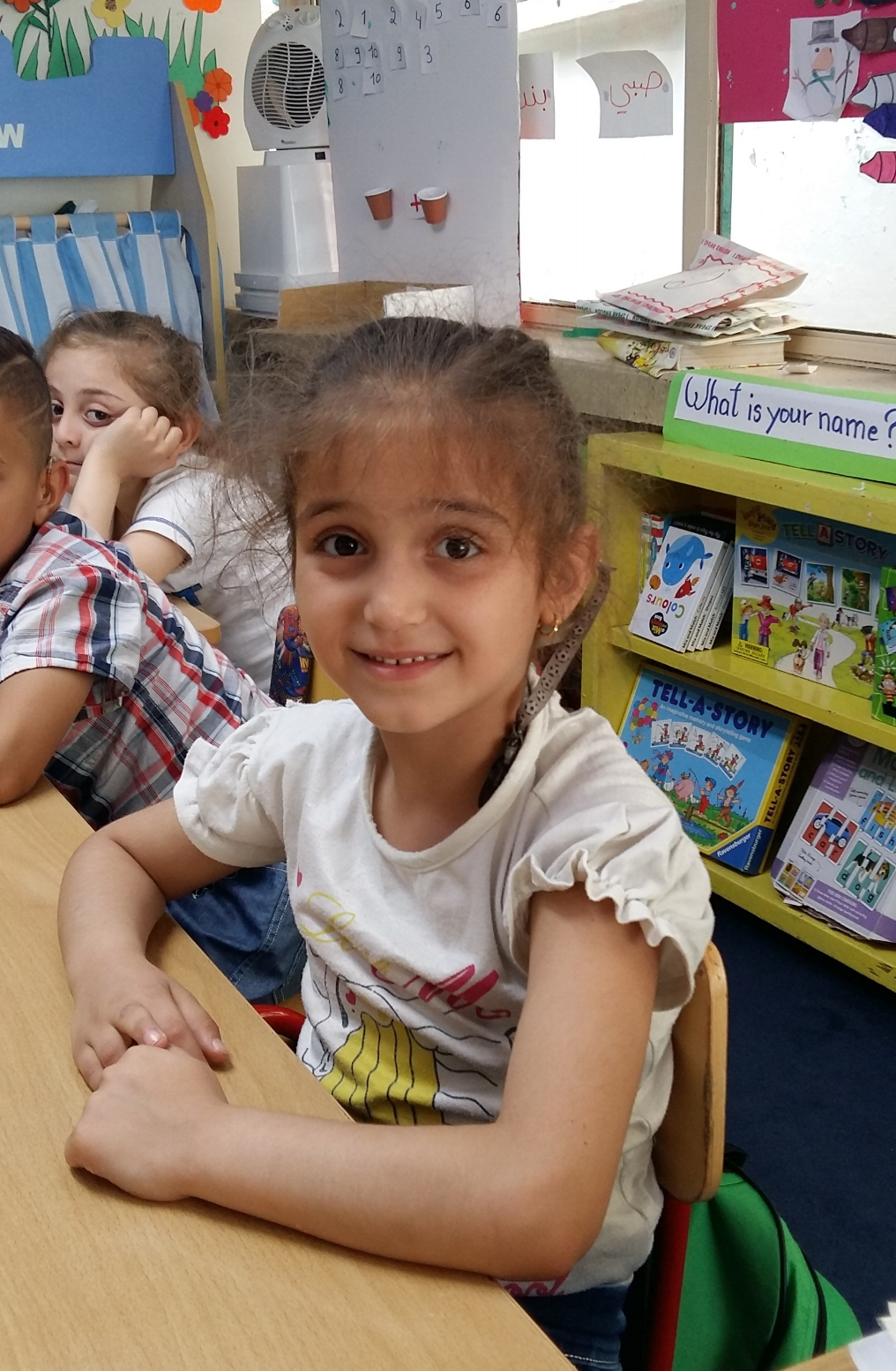 Lougain - Lougain is a 6 year old Syrian refugee. She came to FAID (WDR Partner) having been turned away by every other deaf school because she is Syrian and had significant behaviour problems.  When she first came to FAID, she had virtually no way of communicating which made her very frustrated, angry and quite aggressive.Her teacher at FAID says,