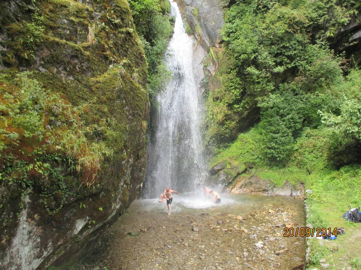 Showering in a waterfall.jpg