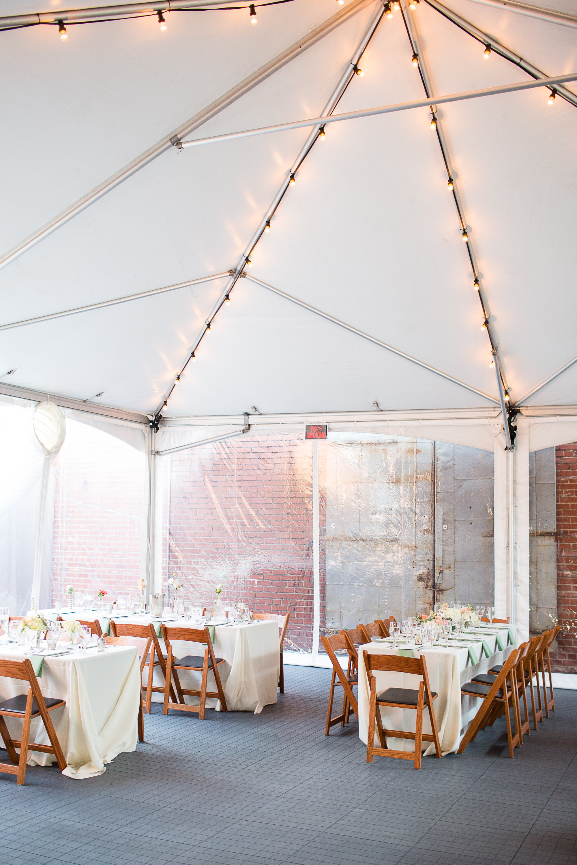 Tent with market lights and walls to contain heating and cooling. Flooring also shown here.