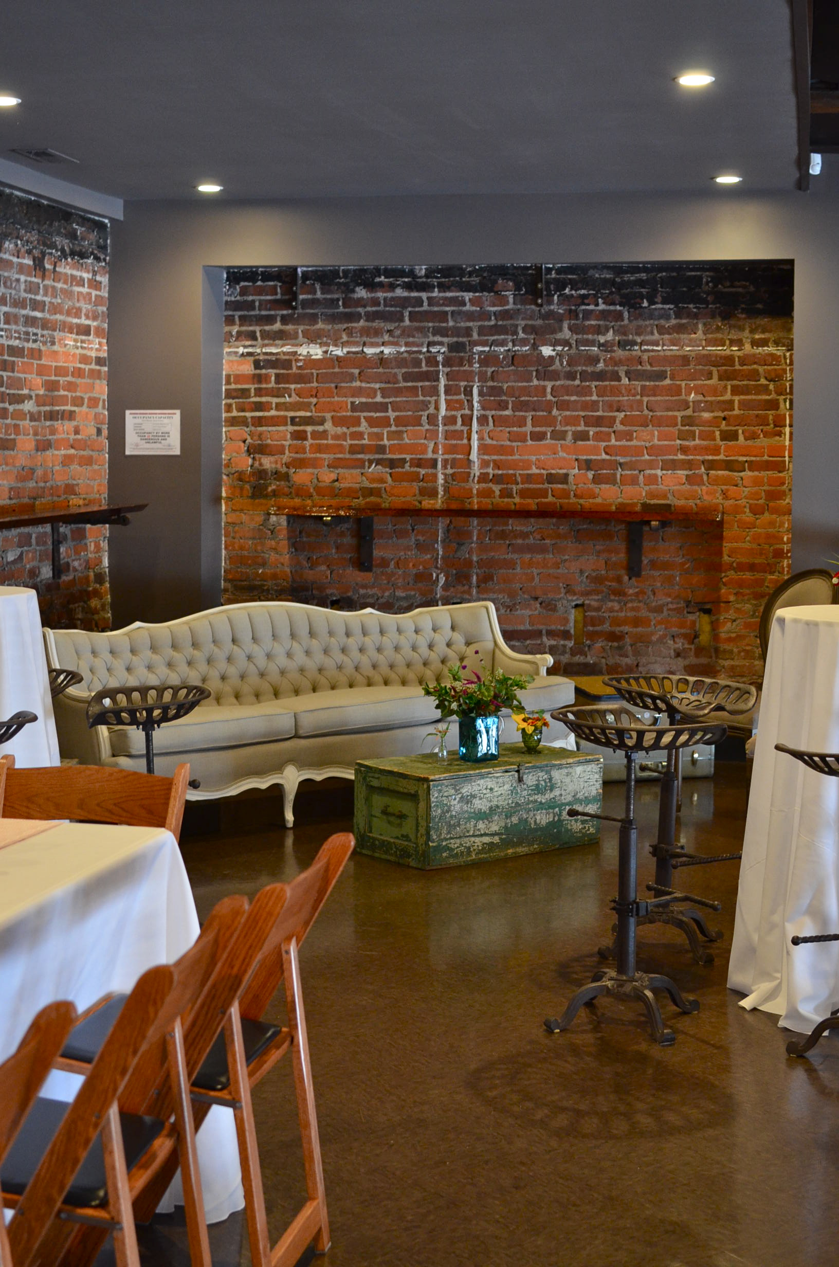 Vintage furniture rentals create a creative lounge area