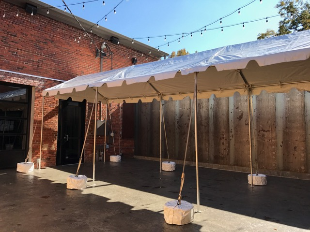 Open-air marquee tent connects the Front Room and Ballroom in the Courtyard.