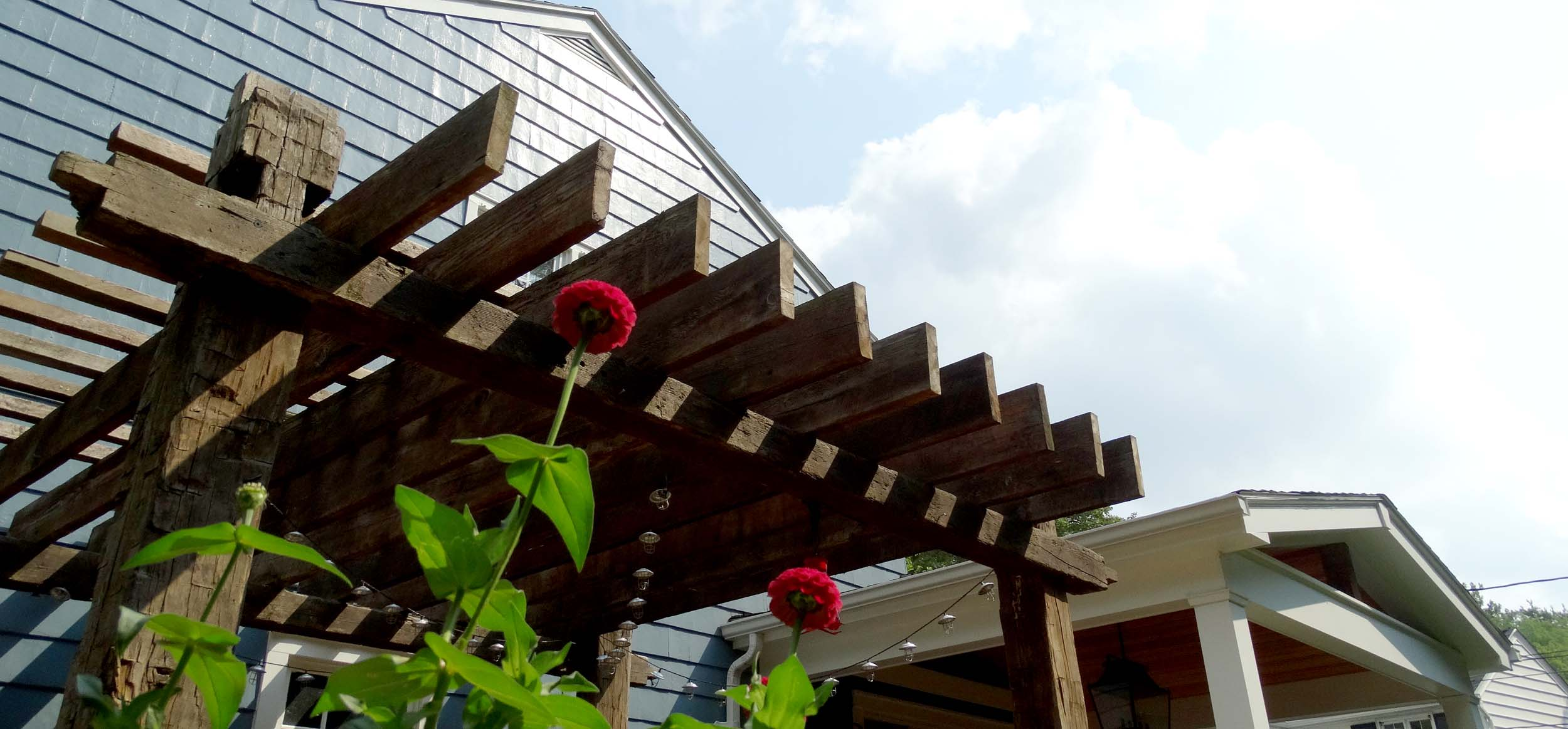 It's all a matter of persepctive under this pergola - sun porch combo.  Can't decide? No worries.  We built both.
