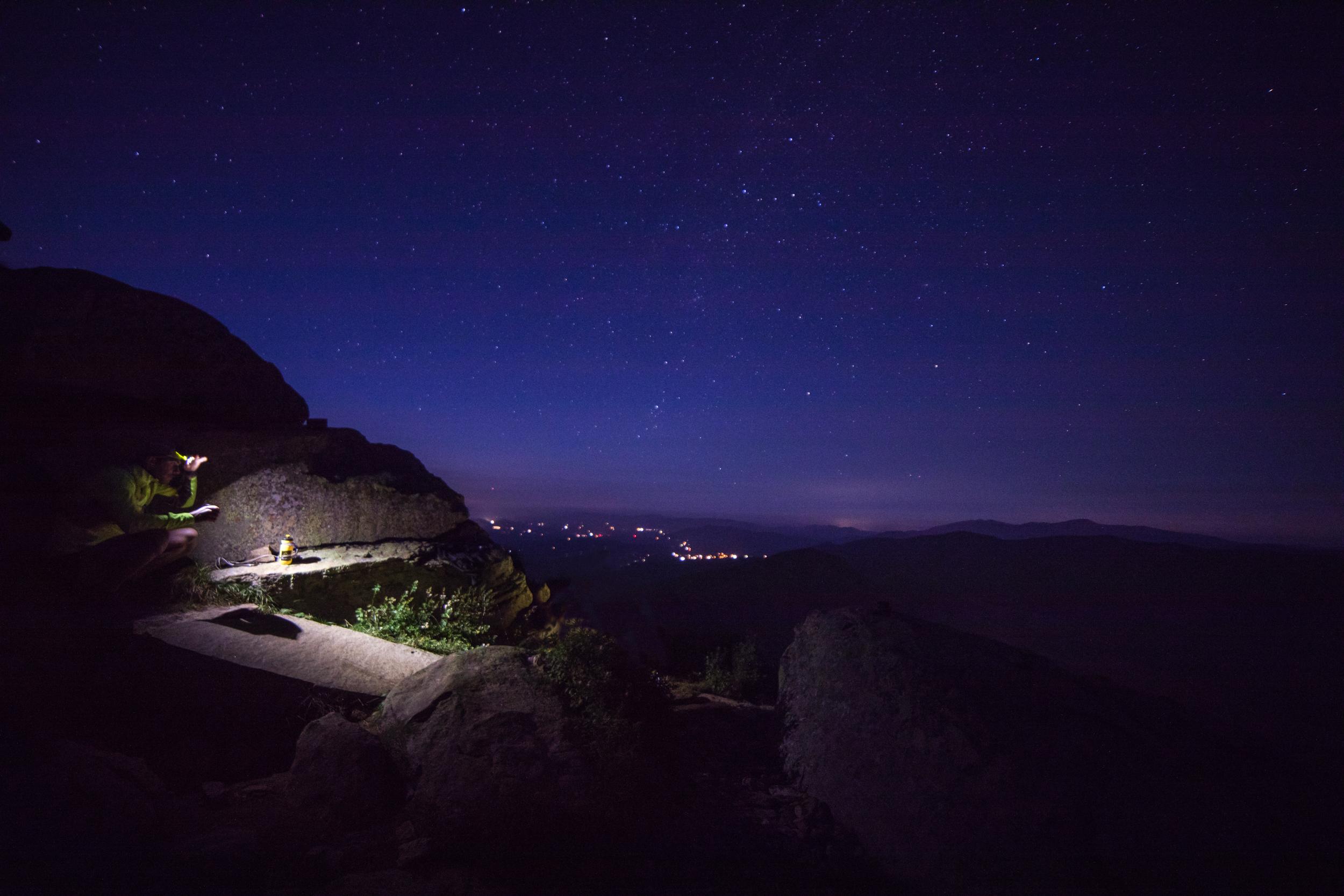 Hunter Cote recharging for a night hike off Franconia Ridge.