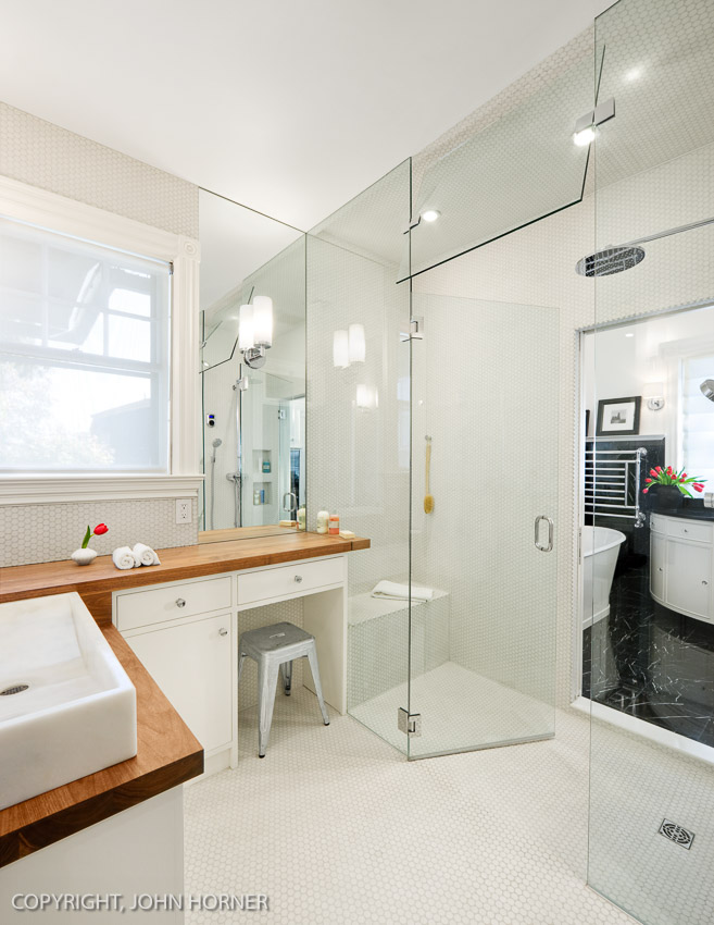 Two bathroom renovations with shared central shower