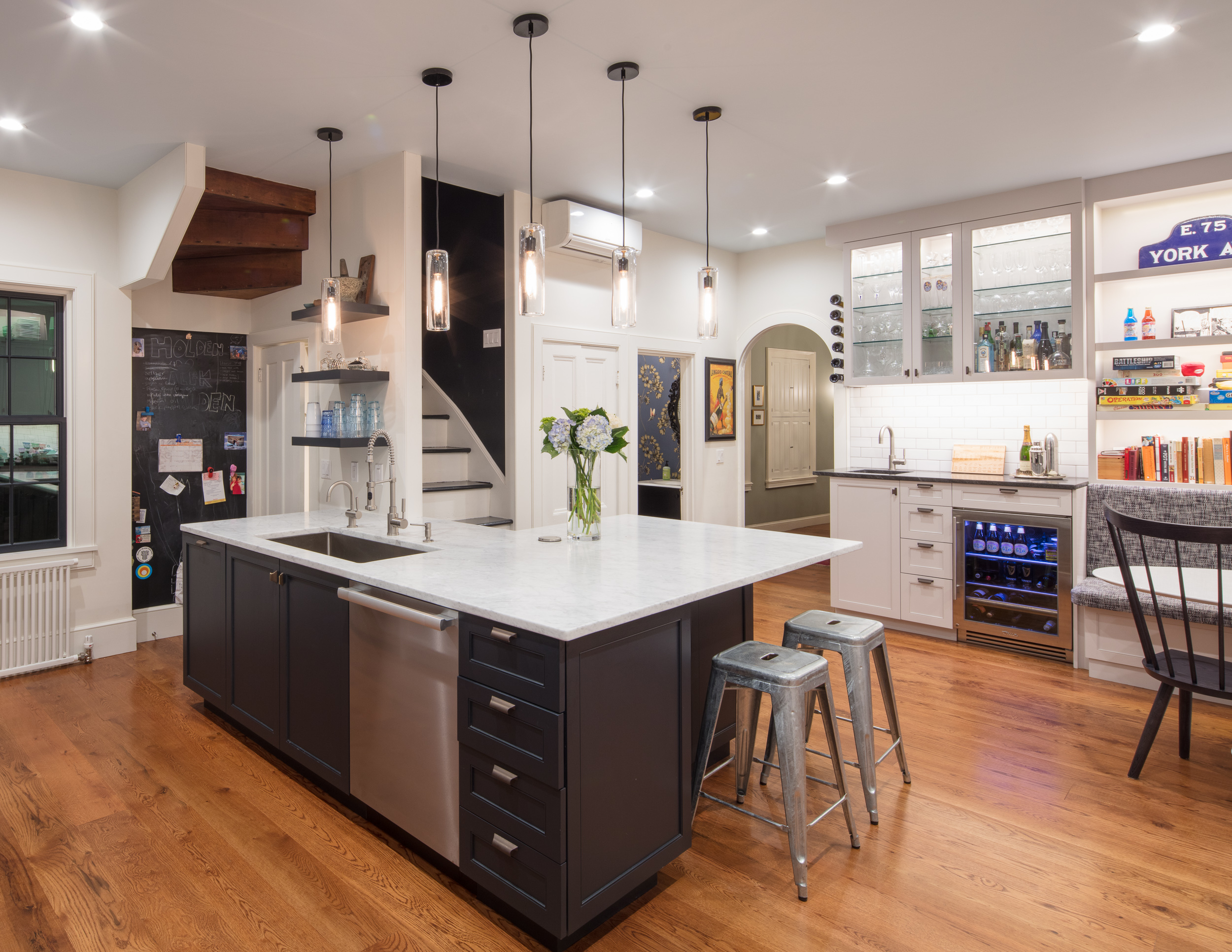 Kitchen renovation with an 8-foot addition and a black and white design.