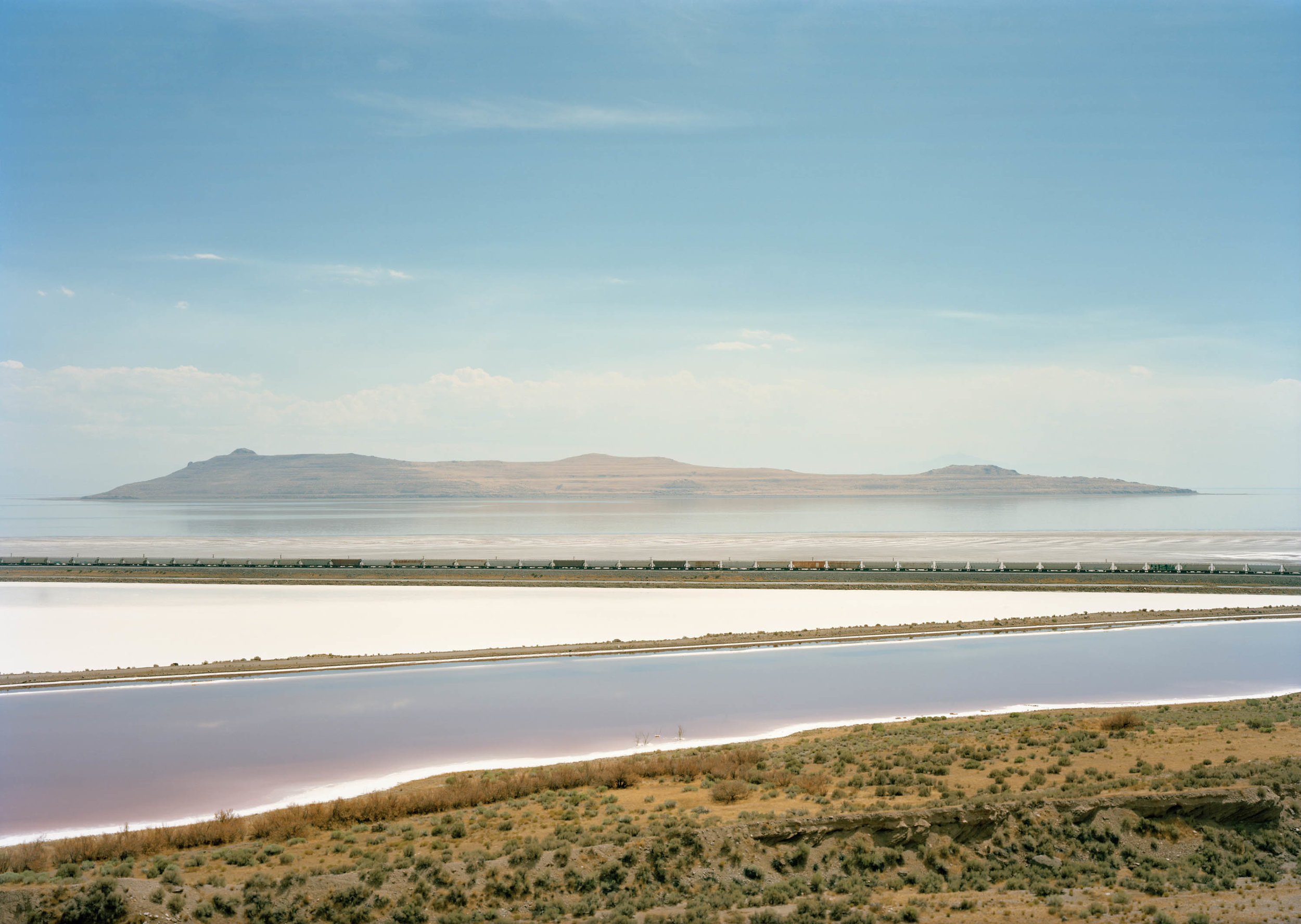 Image © Victoria Sambunaris.  Untitled , (Train crossing Great Salt Lake, UT), 2016. (Click to see full image). Courtesy of the artist.