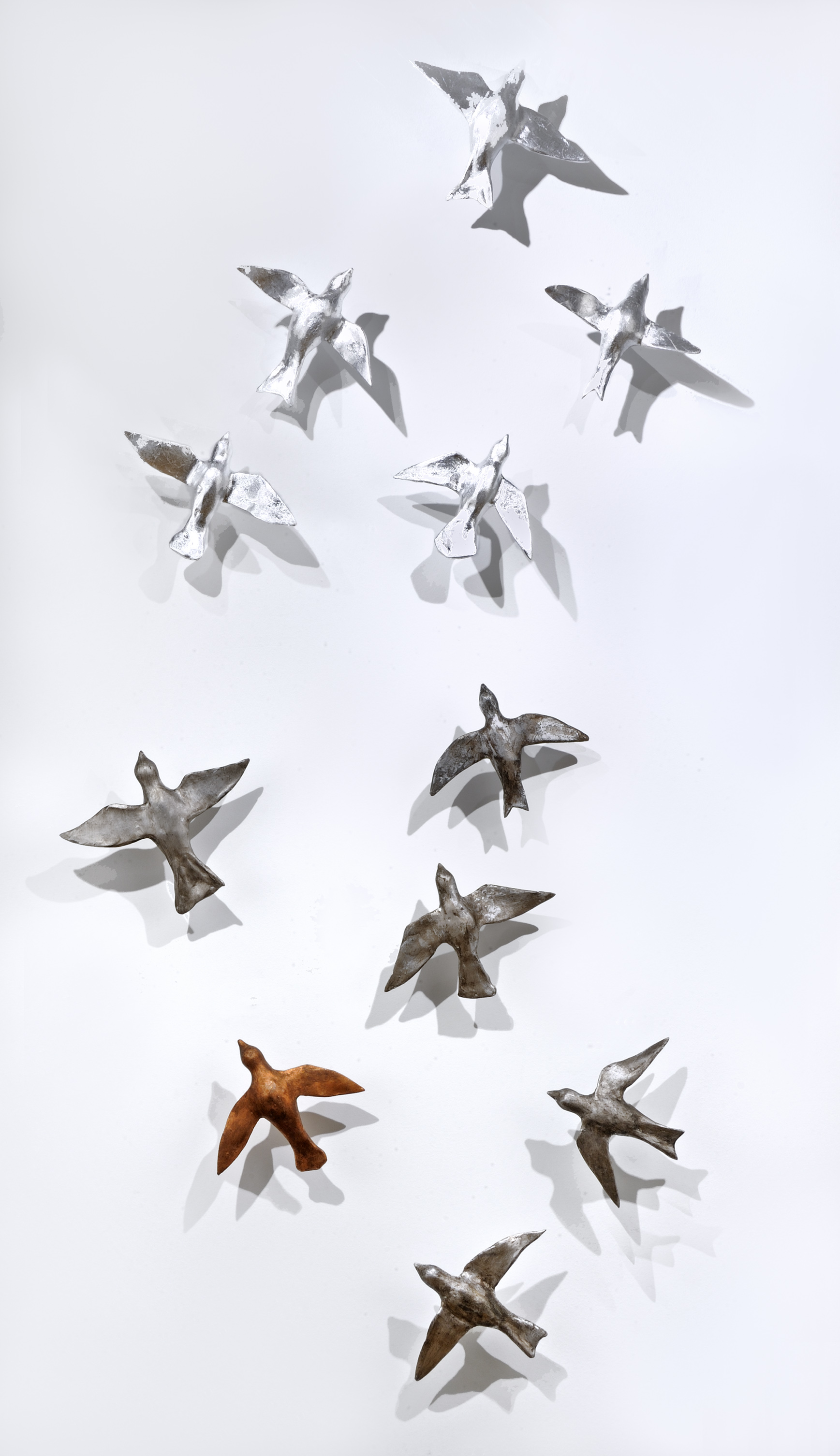 Hostetler_Sunlit Birds_2017_clay with metal leaf_7x3ft_$2,500.jpg