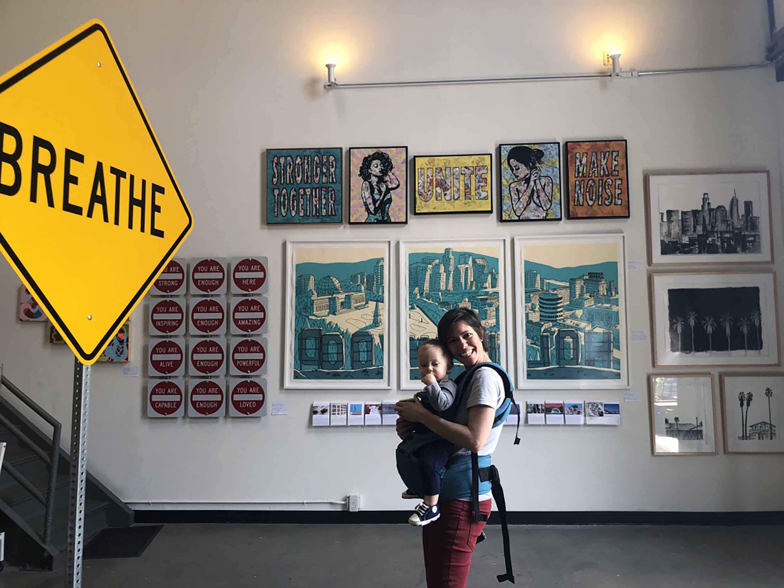 Artist Amy Smith with son in front of her artwork at Wallspace LA during Brewery Art Walk 2018