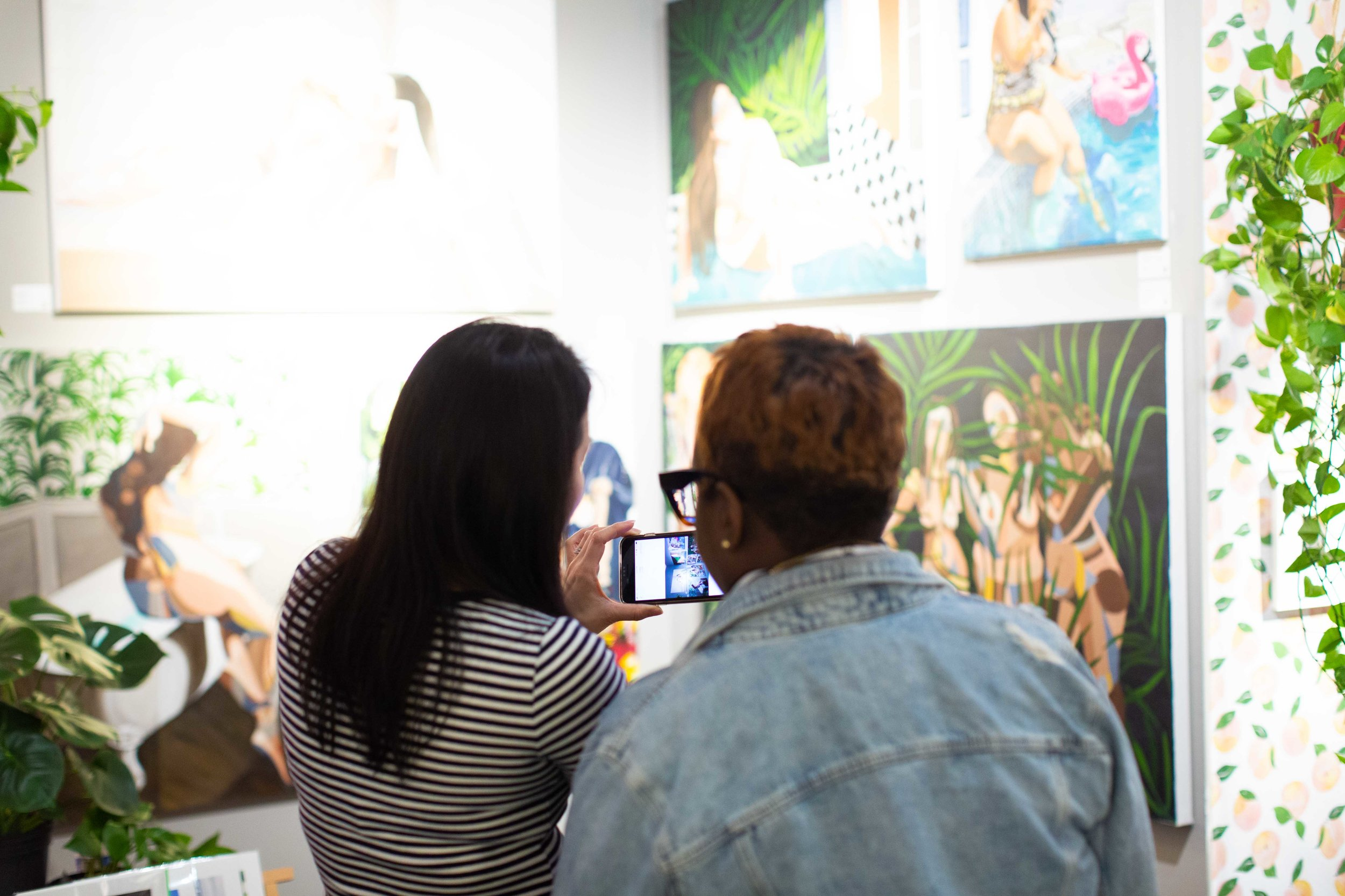 Viewers capture Valenti's work at Superfine! Photo by James Miille