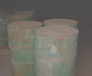 Steel drums on ocean floor, leaking toxic material