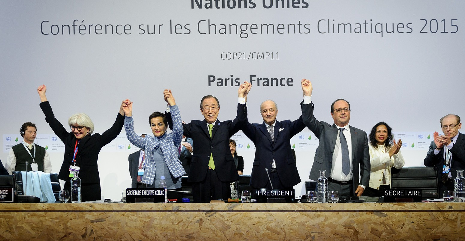 Delegates celebrate after the signing of the Paris Agreement. Source: Carbonbrief.org