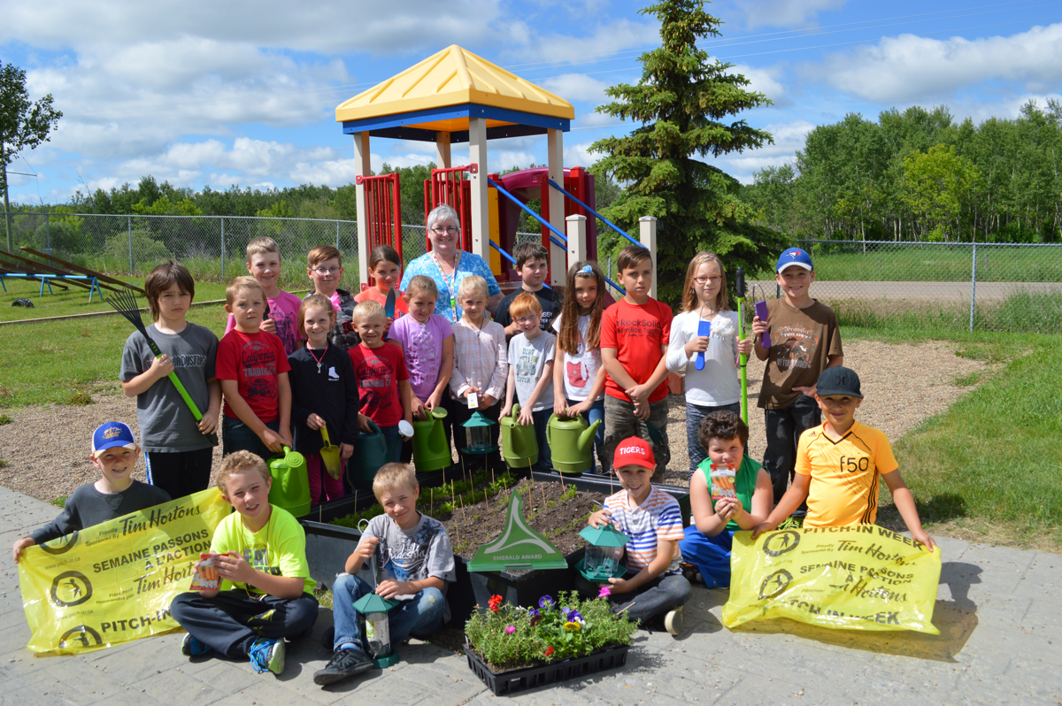 Geralyn McCormack and the Warriors of the Rainbow with their Emerald Award-winning garden