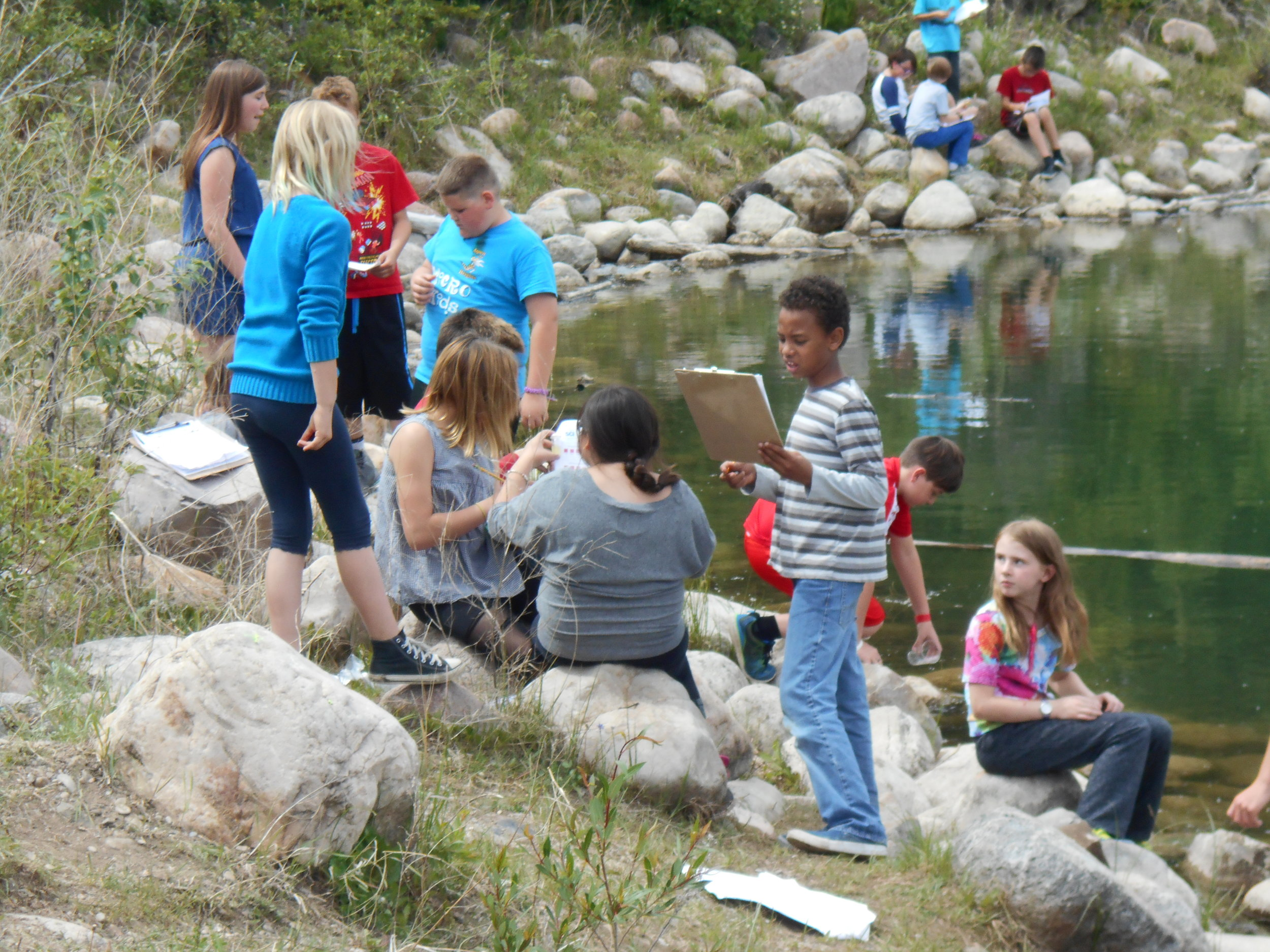 Students from Aspen Heights Elementary on the shore of a local pond
