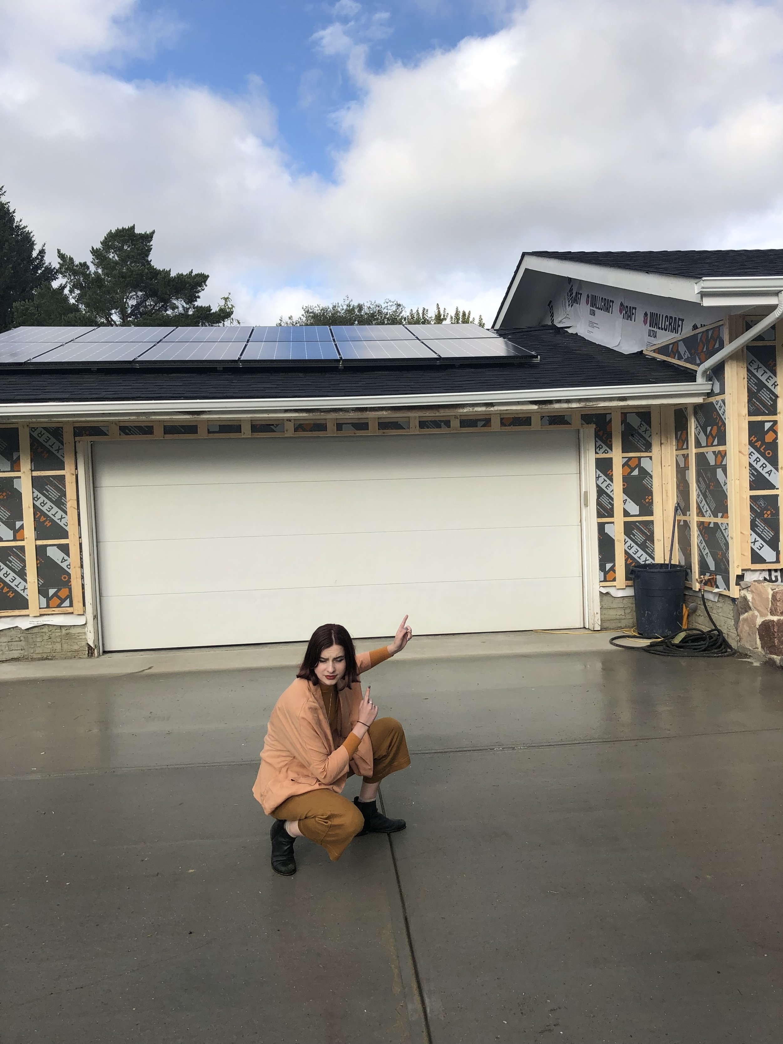 Figure 2: Me in front of the solar on my parents house.. unlike a solar panel, my eyes were not liking the sun