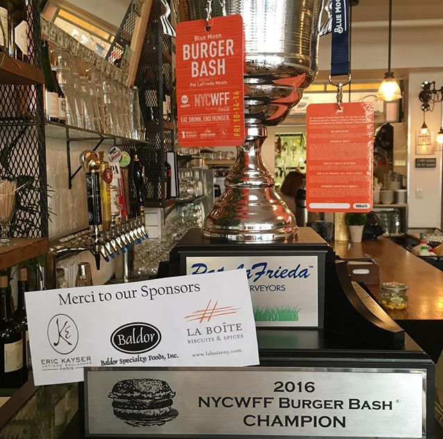 """David's Cafe has won the New York City Wine & Food Festivals 2016 Burger Bash presented by Pat La Frieda Meats and hosted by Rachel Ray. Our """"Burger Queen"""" was selected the Judges Choice winner. Click the link below for more information on the contest.Our thanks to the sponsors and all of the other competitors.   2016 Burger Bash   Come by the cafe, check out the trophy and try our champion Burger Queen today!"""