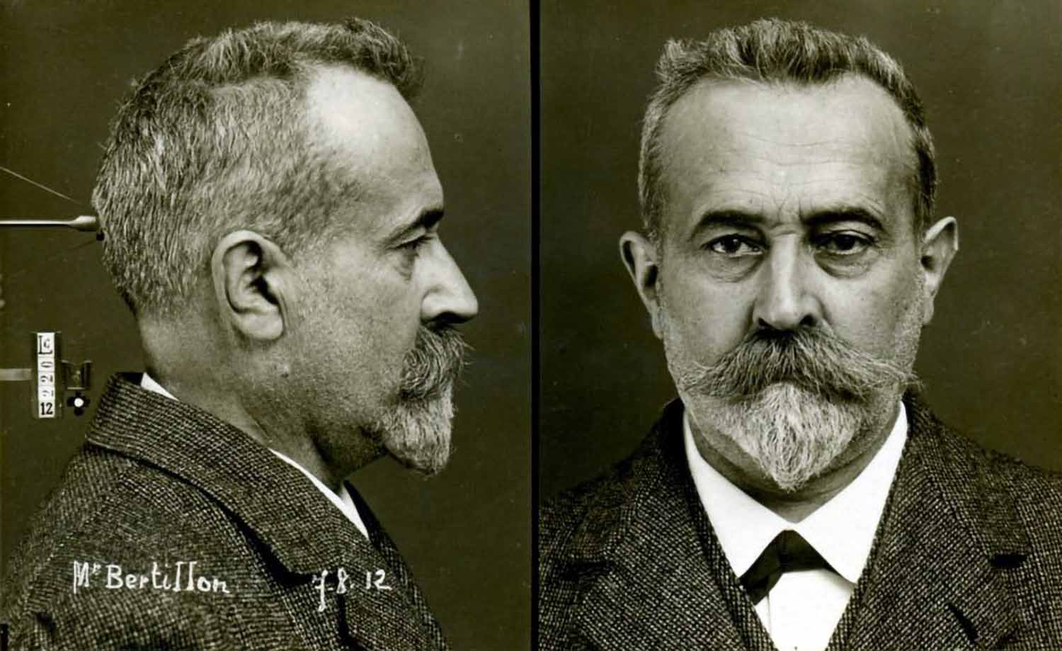 Alphonse Bertillon self portrait in the standardized mugshot template he developed in 1888.