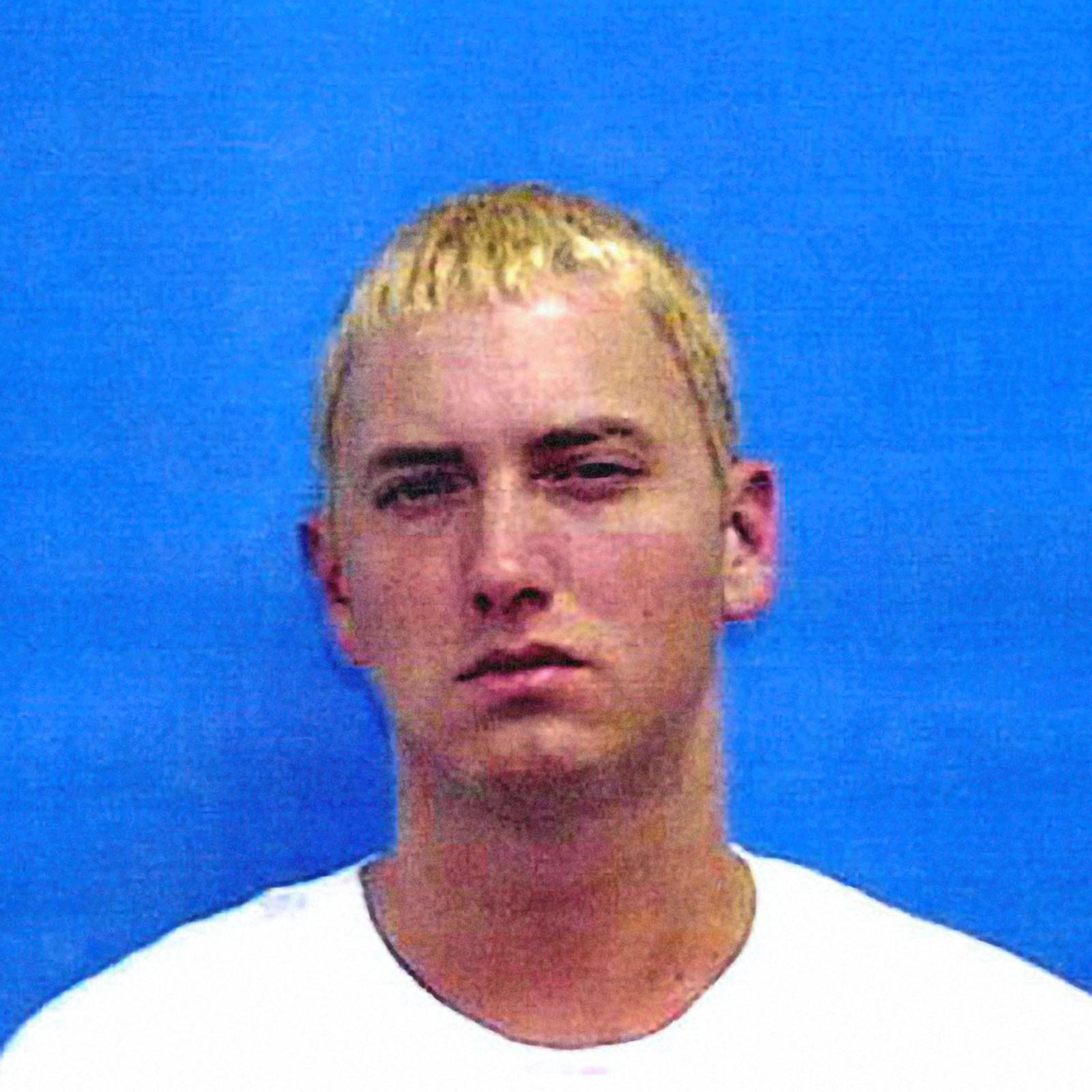 "Marshall Bruce Mathers III, aka ""Eminem"", 2000   Eminem was  arrested on June 4, 2000  and charged with pistol-whipping a man who was allegedly kissing his wife, Kim Mathers, outside the Hard Rock Sports Bar in Warren, Michigan. Prosecutors dropped a charge of assault with a dangerous weapon as part of the plea agreement where Eminem plead guilty to carrying a concealed weapon and was sentenced to two-years probation."