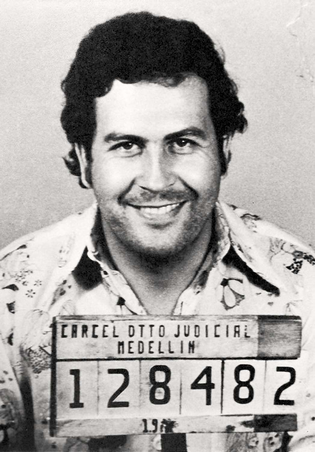 Pablo Escobar mugshot in 1977 by the Medellin Control Agency. At the height of his power, Escobar imported $70mm per day of cocaine into the U.S.