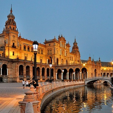Sevilla    The capital of Andalucía, Sevilla is enchanting and magical. From the  barrio of Santa Cruz  to the district of  Triana , flamenco is the heartbeat of this city and it hosts the  Bienal de Flamenco  every other year, one of the largest and most popular flamenco events in the world.