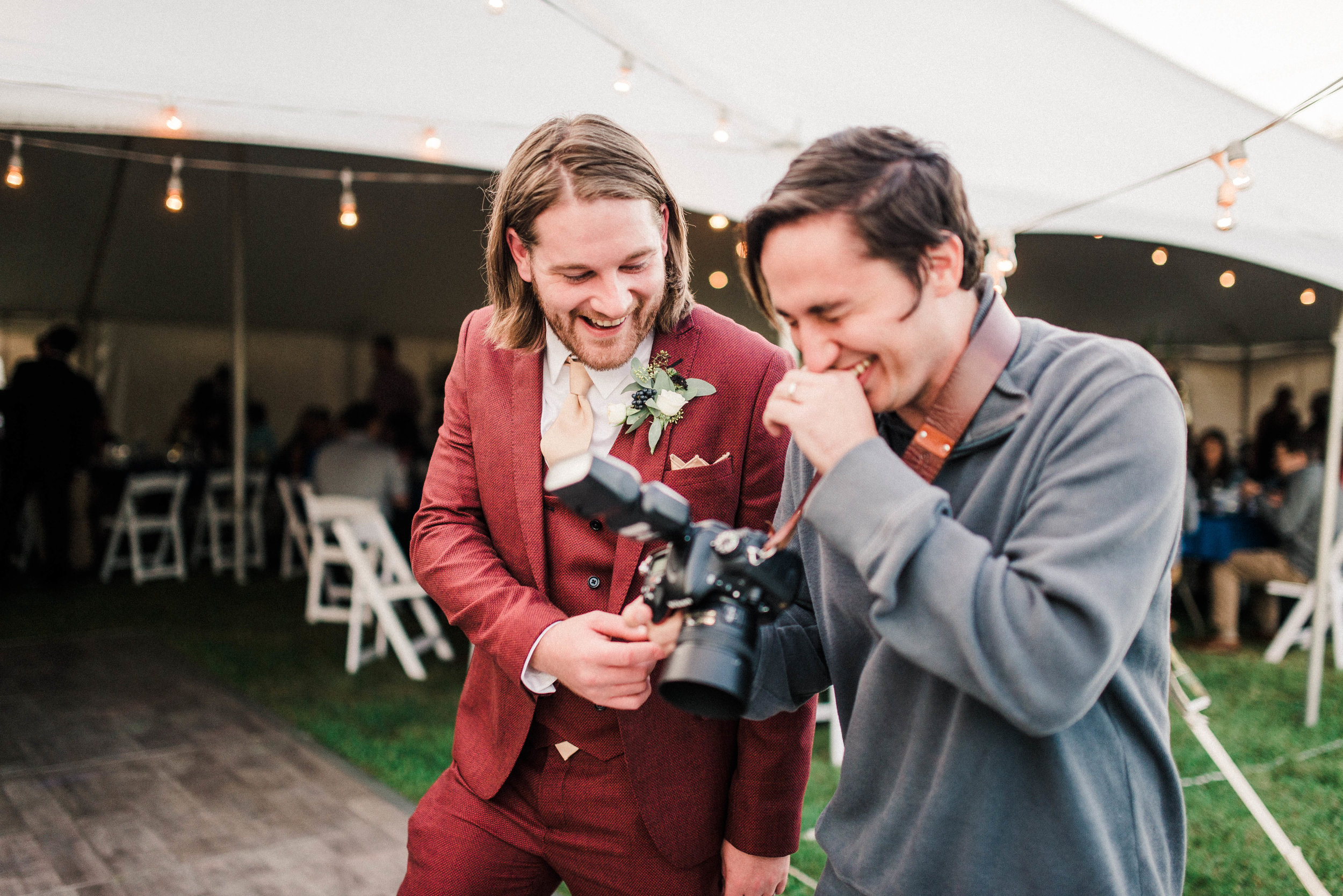 Mike and one of our awesome grooms cracking up after the garter toss.