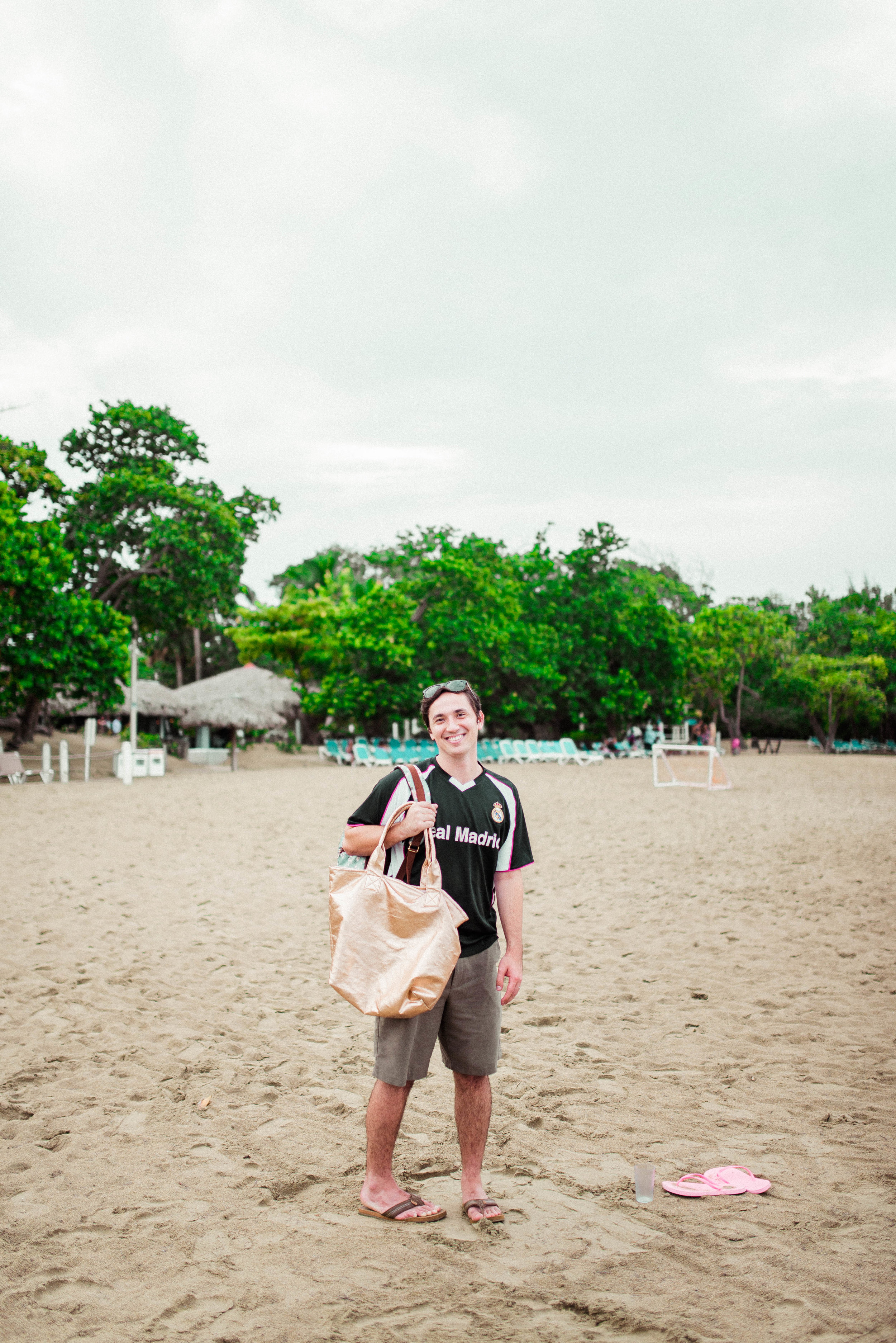 Mike held everyone's bags (and a drink) during a honeymoon session in the Dominican Republic! This was the bride's only requested photo because she just loved how content Mike looked! Ha!