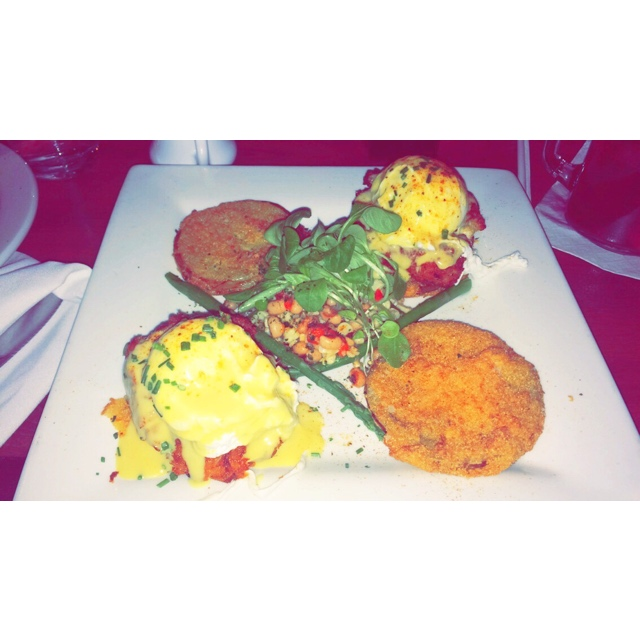 Crab Cake & Fried Green Tomato Eggs Benedict:Poached Eggs & Mini Jumbo Lump           Crab Cakes on Fried Green Tomatoes, Black Eyed Pea Succotash with Asparagus &                                 Old Bay Hollandaise, dusted with Old Bay