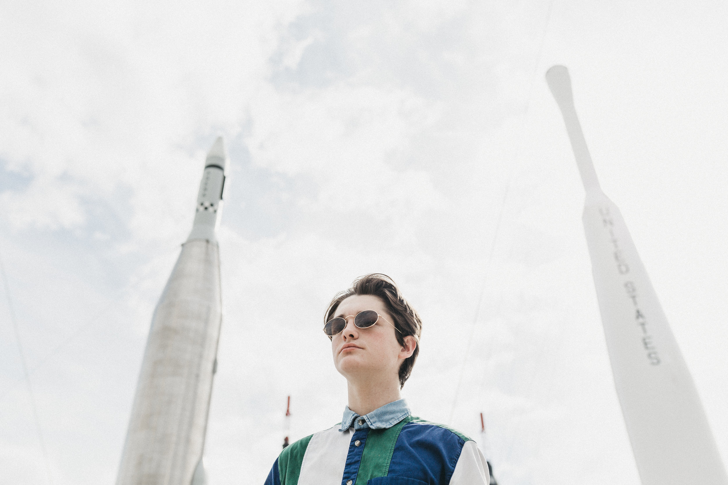 male portraits with rockets