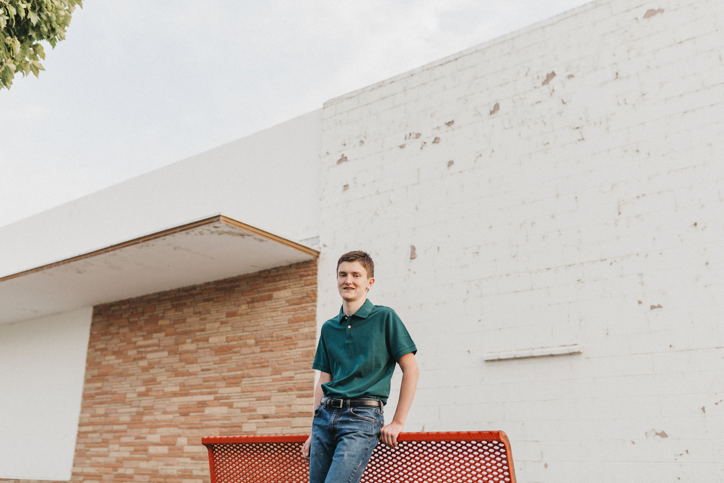 male senior photo at Uptown Shopping Center
